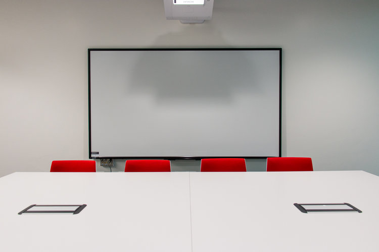 Larger meeting room with an interactive display board