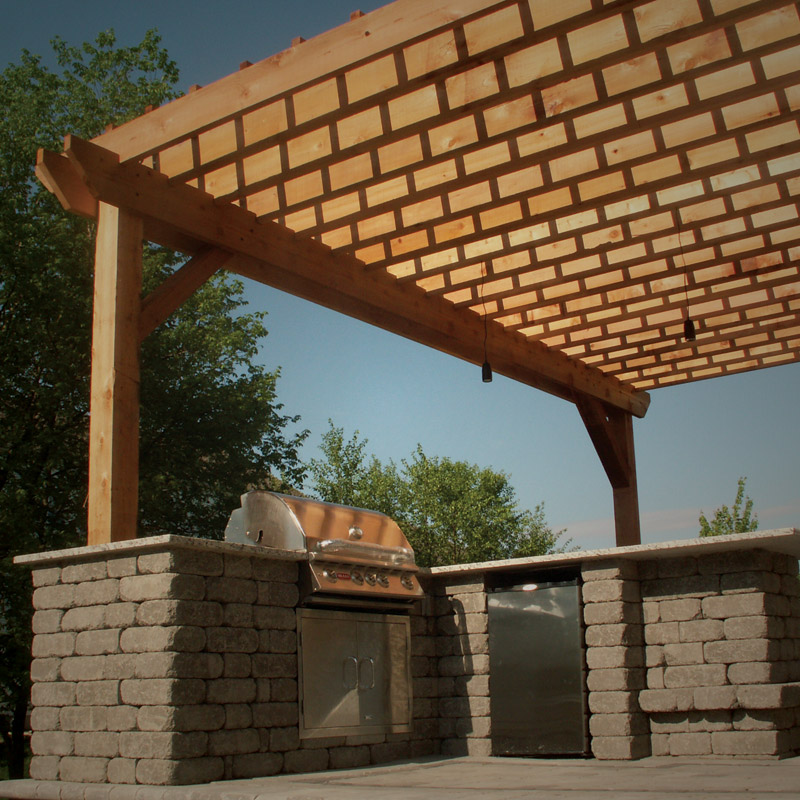 pergula and outdoor kitchen by 9 Trees Landscape Construction