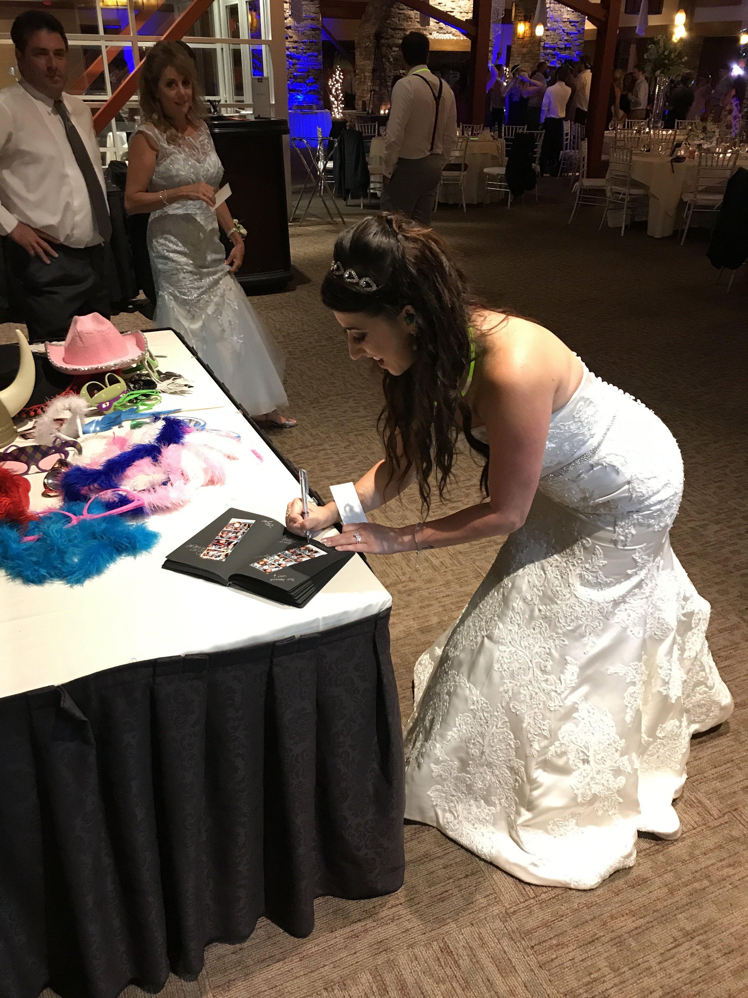 Bride signing memory book