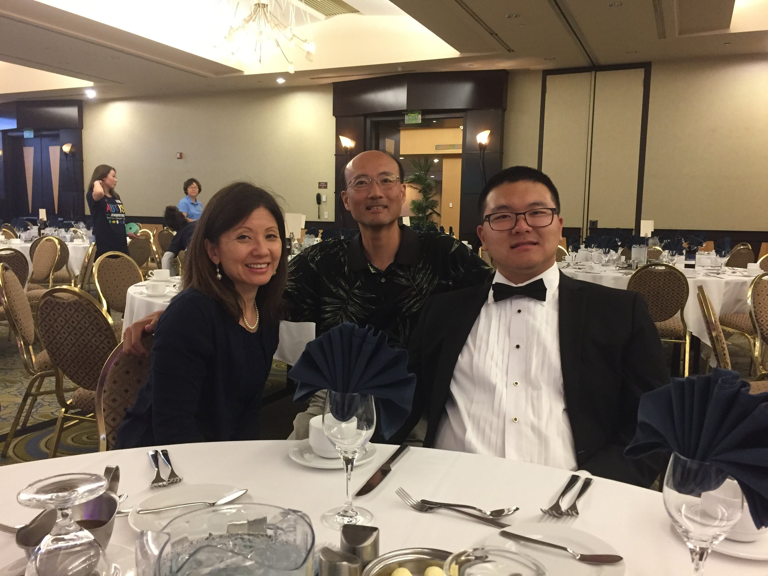 Wonkoo Chang and   Johnna   Cho with their son, Kevin, who played a clarinet solo for a fundraiser hosted by the Korean American Special Education Center in recognition of World Autism Awareness Day. Photo courtesy: Johnna Cho
