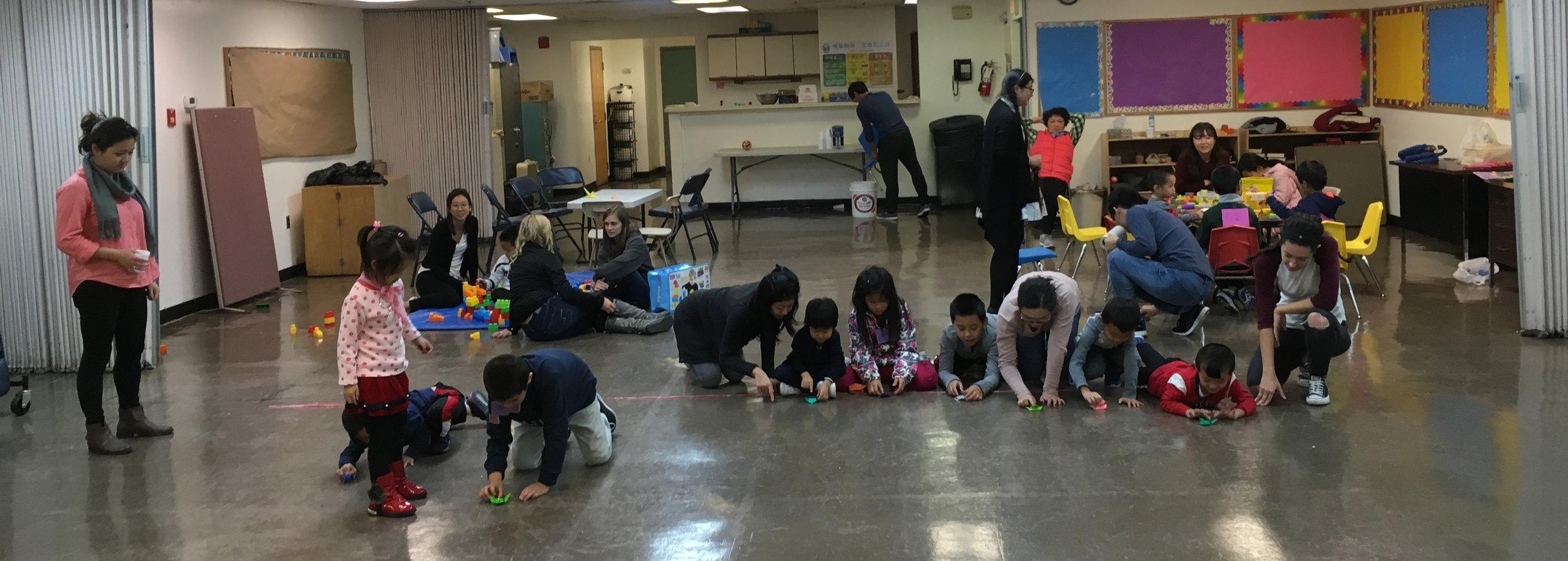 Children at the Philadelphia Asian Family Health Resource practice social skills through origami frog races.Photo courtesy: Christina Lam