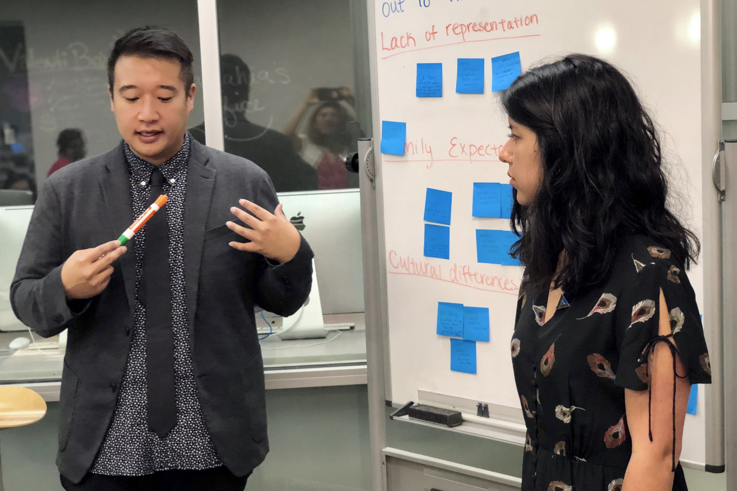 Voices mentors  Frank Shyong , left, and  Jill Cowan  help their students come up with an story outline on a project about the experiences of LGBTQ Asian Americans coming out.