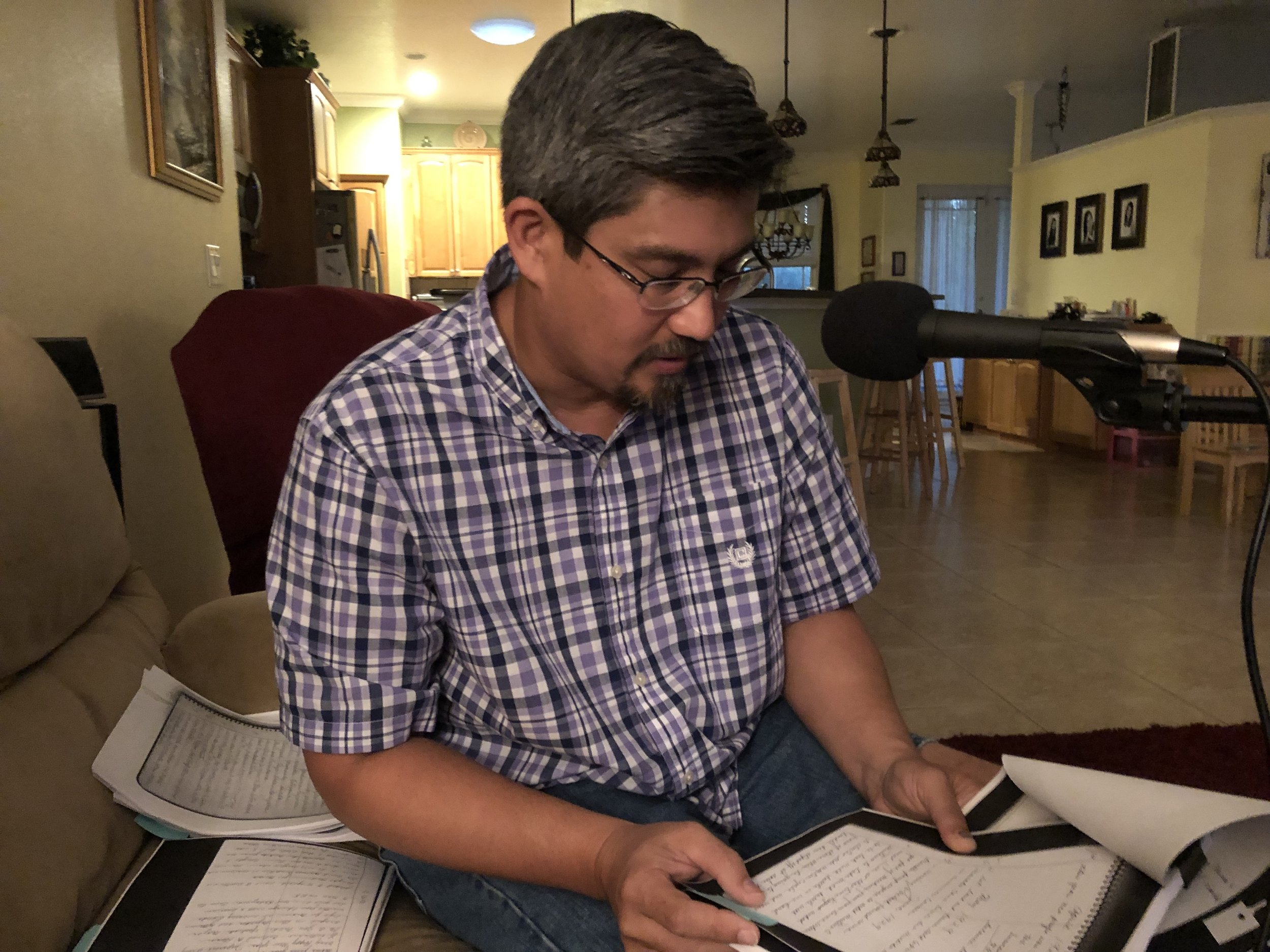 Sage Kamiya reads translated copies of his great grandfather's journal in his home in Bradenton, Florida. Photo by Alyssa Ramos.
