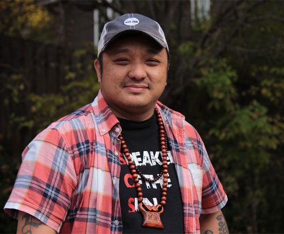 Tou SaiKo Lee poses for a photo in St. Paul, Minnesota. Photo credit: Kevin Yang.