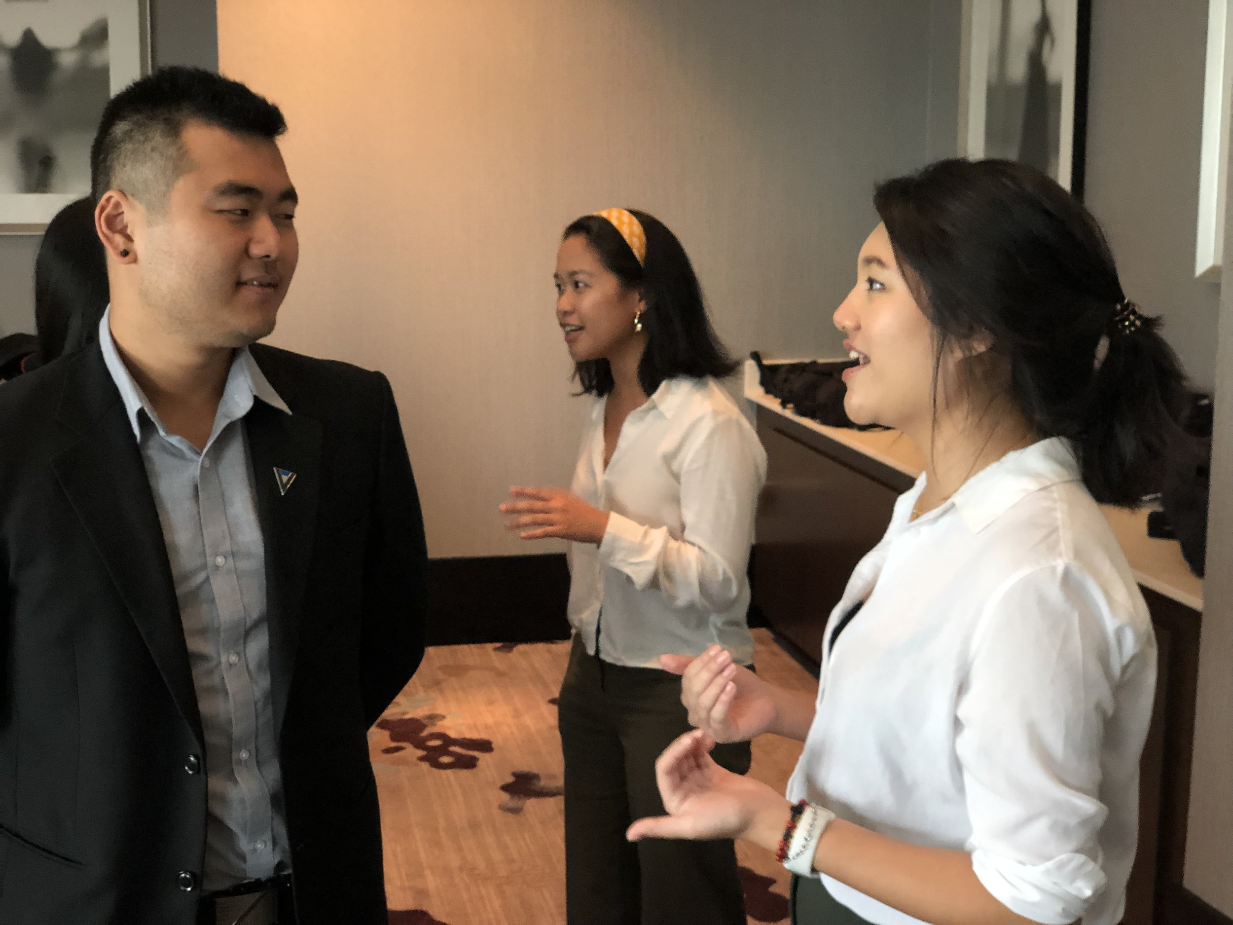 Souichi Terada and Alyssa Ramos practice networking skills.