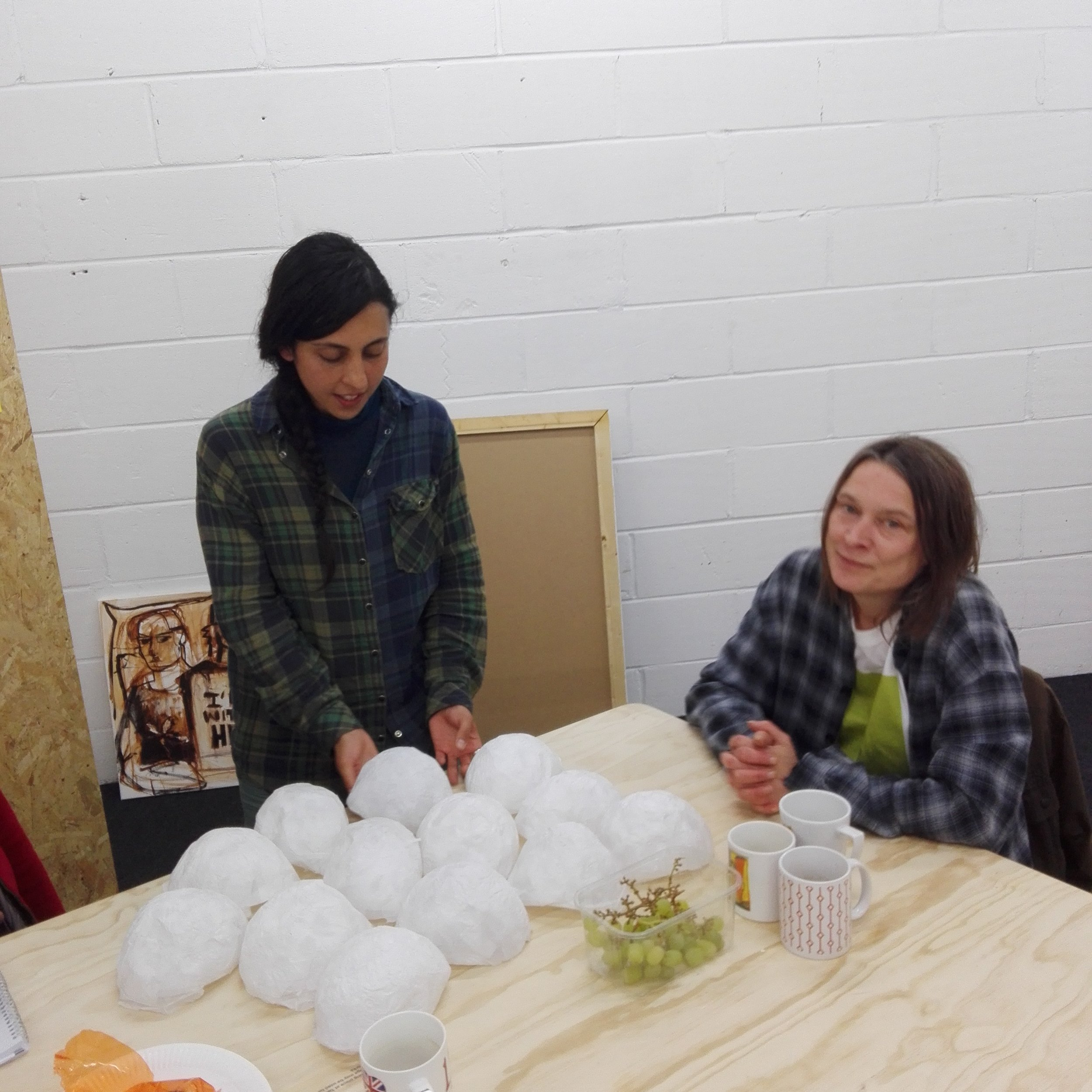 TOMA  artist  Gloria Sulli  in a crit with visiting artist  Sarah Lucas .