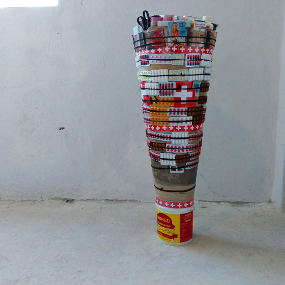 Lafleur & Bogaert,   Famasi Mobil Kongolè , 2018, Electric lights, Congo Blue filter sheets, hand painted cardboard, plastic buckets, multicolored pills, rubber bands and pairs of scissors, Approx. 50 x 8 x 15 inches, Courtesy of the artists