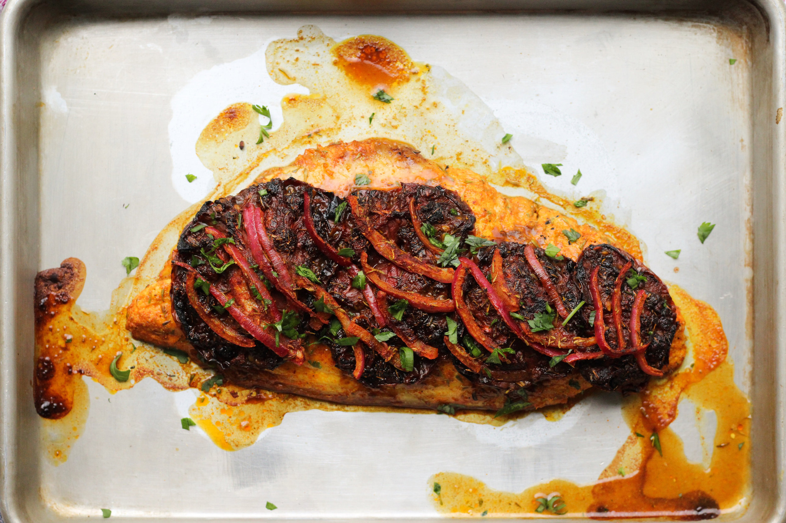masgouf (grilled fish) with slow roast tomatoes
