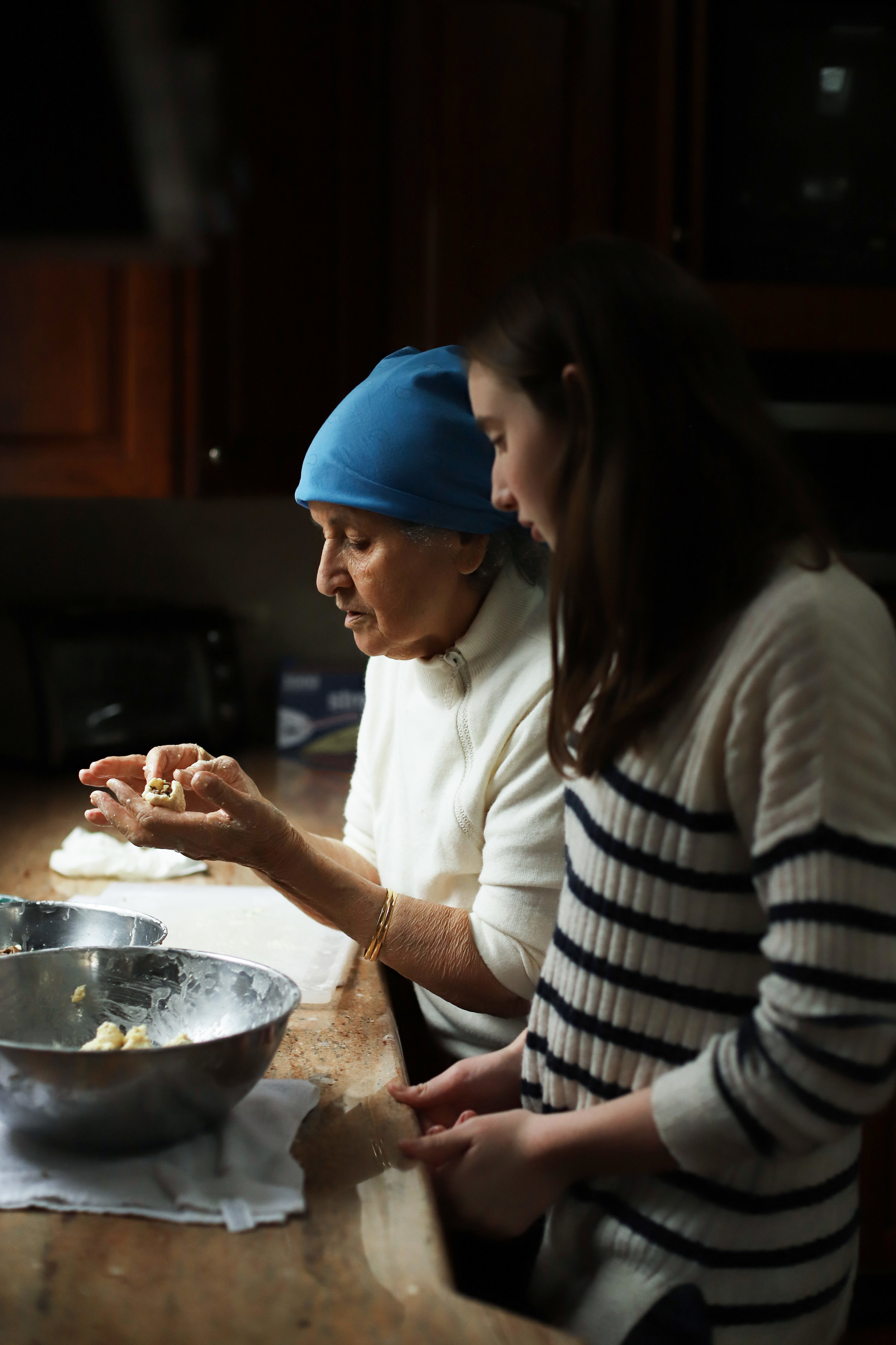My aunt Masy teaching my cousin, Olivia, how to make kbeibat