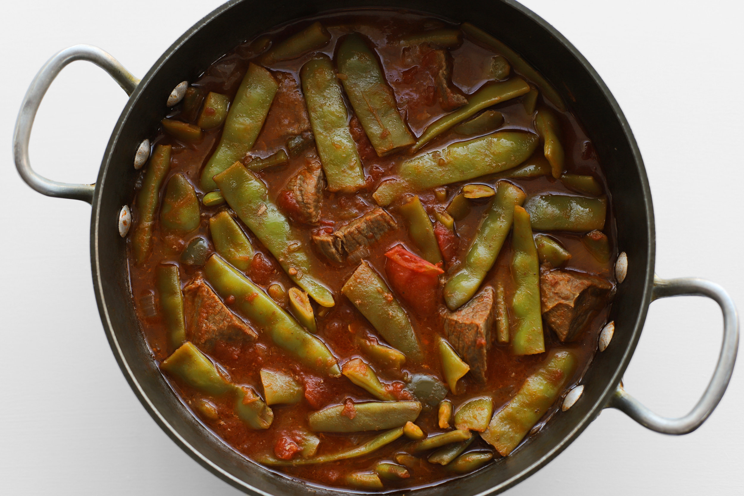 Riza shirw'it fasouleyeh (flat bean stew with rice)    But if I had to pick one that's closest to my heart, it would be riza shirw'it fasouleyeh, because it's the one I had most often growing up. There's a misconception that all Middle Eastern stews are spicy and fragrant, which is not always the case. Some are simply made with delicious vegetables and spiced simply with black pepper.