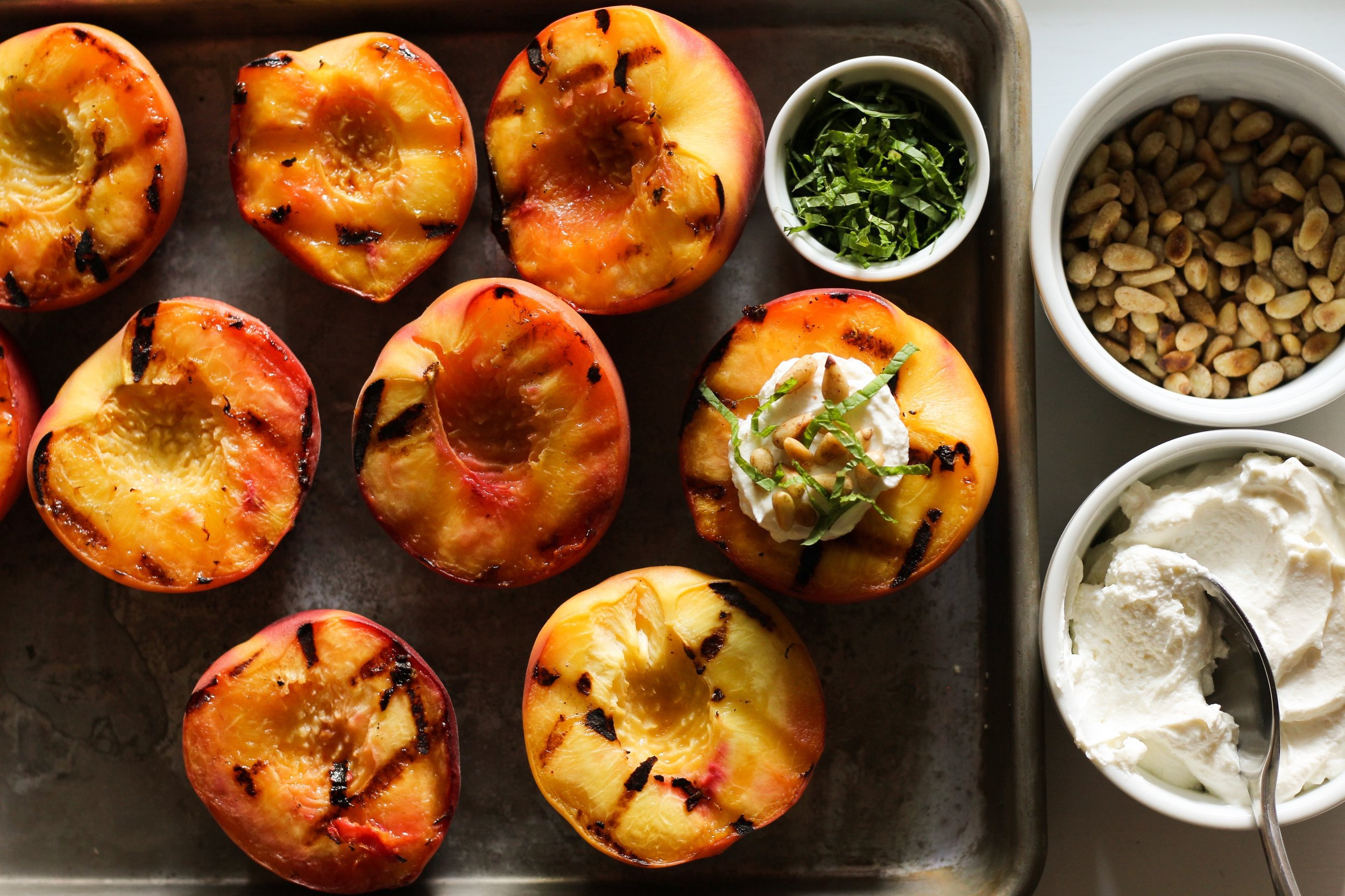 grilled peaches with pine nuts, labneh, and mint