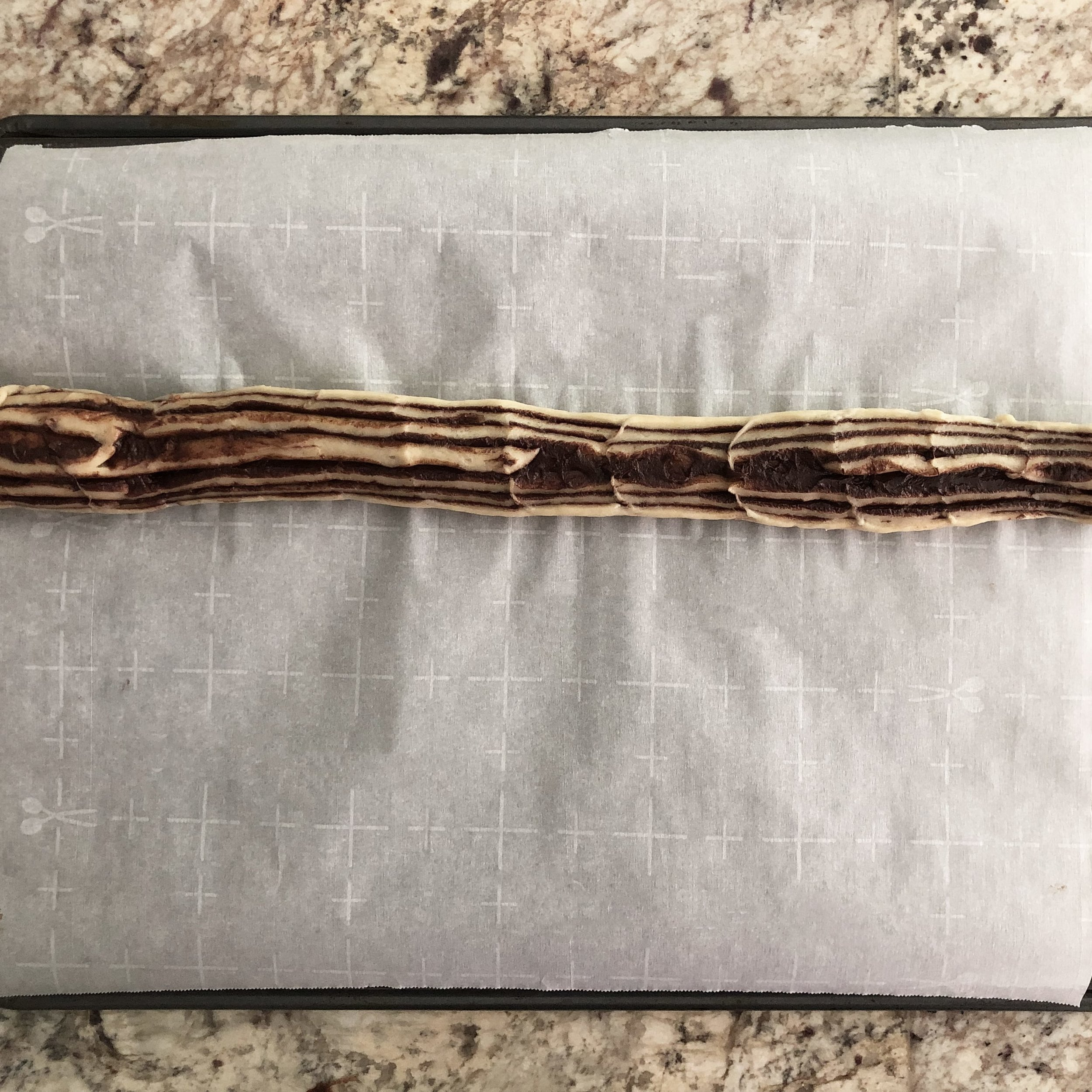 Place the first strip horizontally on a parchment-lined pan.