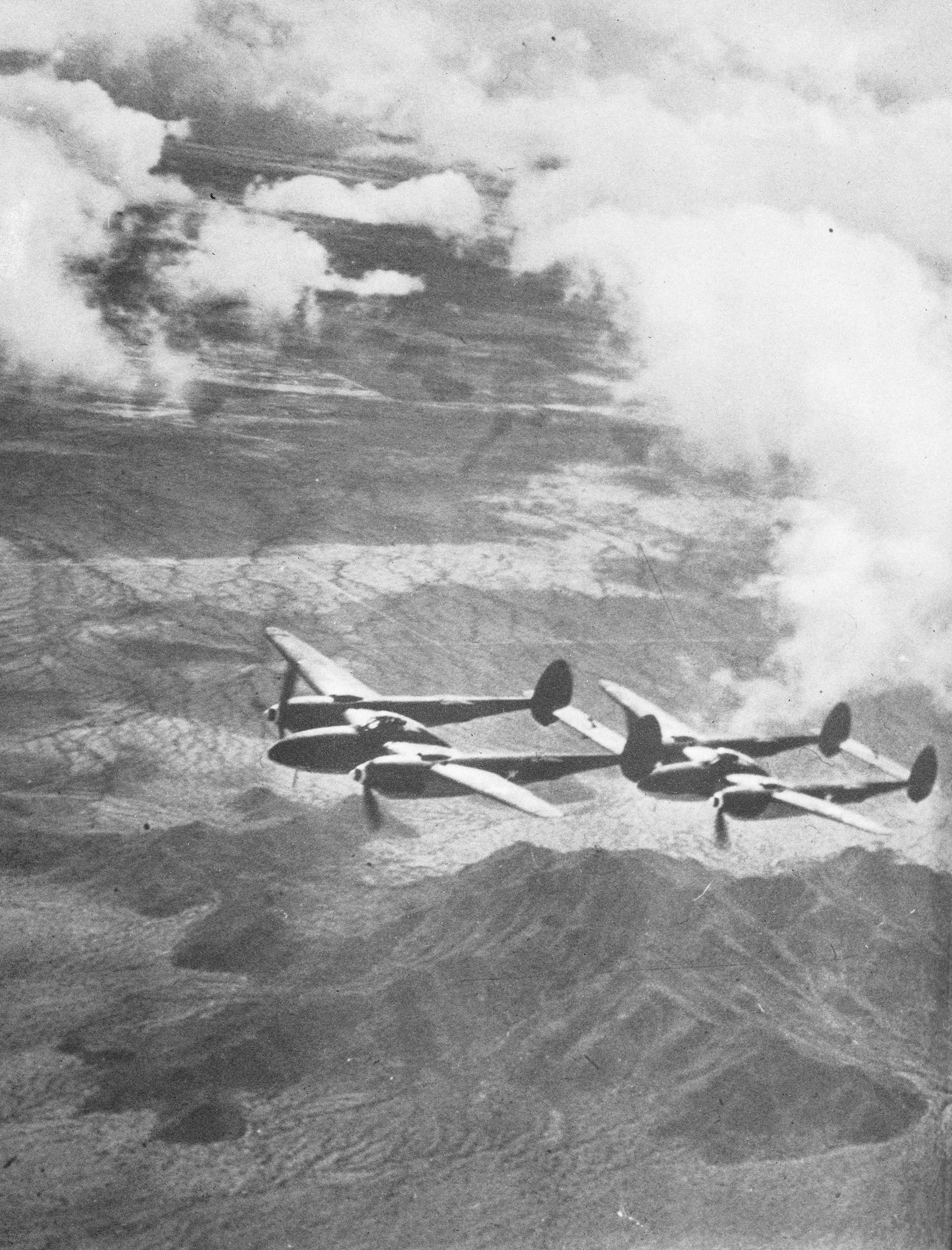 A pair of P-38 Lightnings flying over the Sierra Madera just south of Fort Stockton.