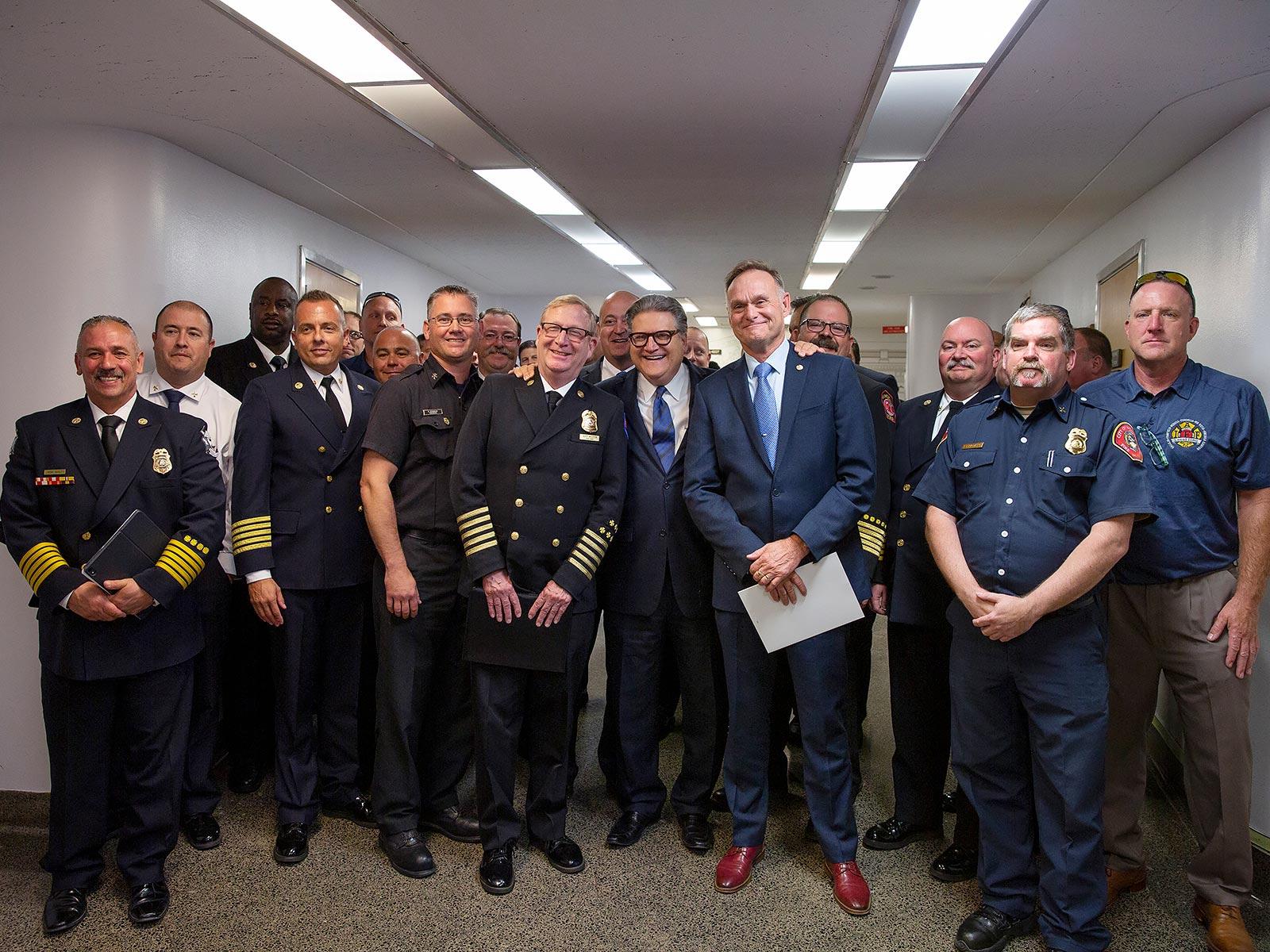 Sen. Robert Hertzberg; Hertzberg (c) with Rice, Meston and firefighters