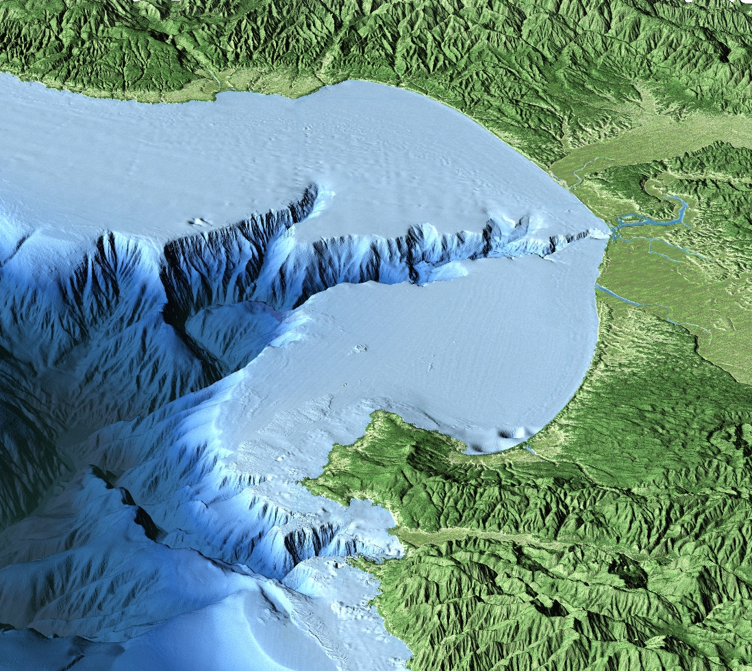 Credit: David Fierstein (c) 2000 MBARI  This aerial view of Monterey Bay from the south was created by combining computer-generated topographic and bathymetric data. Vertical relief has been exaggerated to better show the Monterey Canyon and mountains on either side of the bay.
