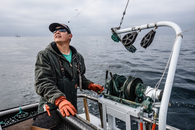 Toriumi checks his gear as he sets up to troll for salmon. Photo credit: David Hills 2018 (Fishy Pictures).