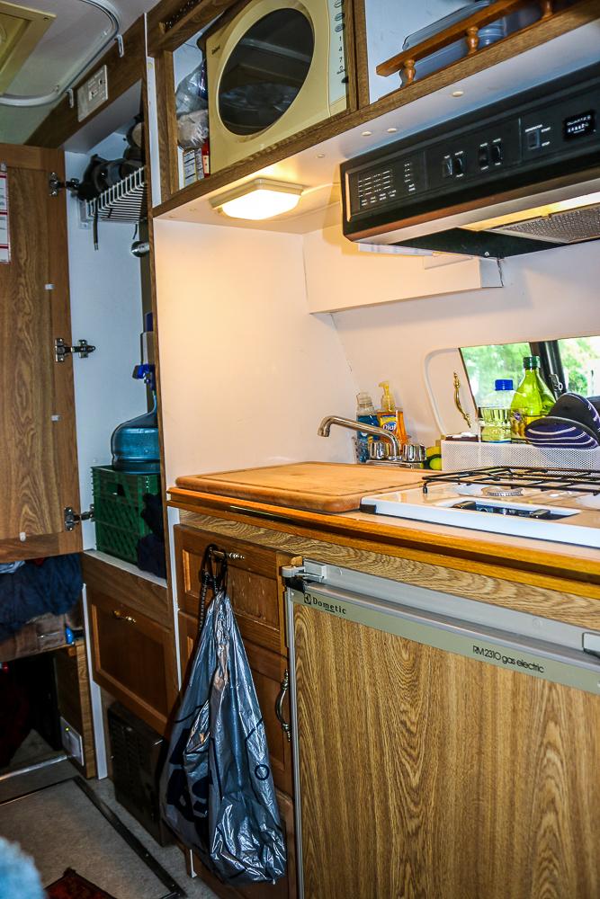 A Pretty Full Kitchen For a Little Van