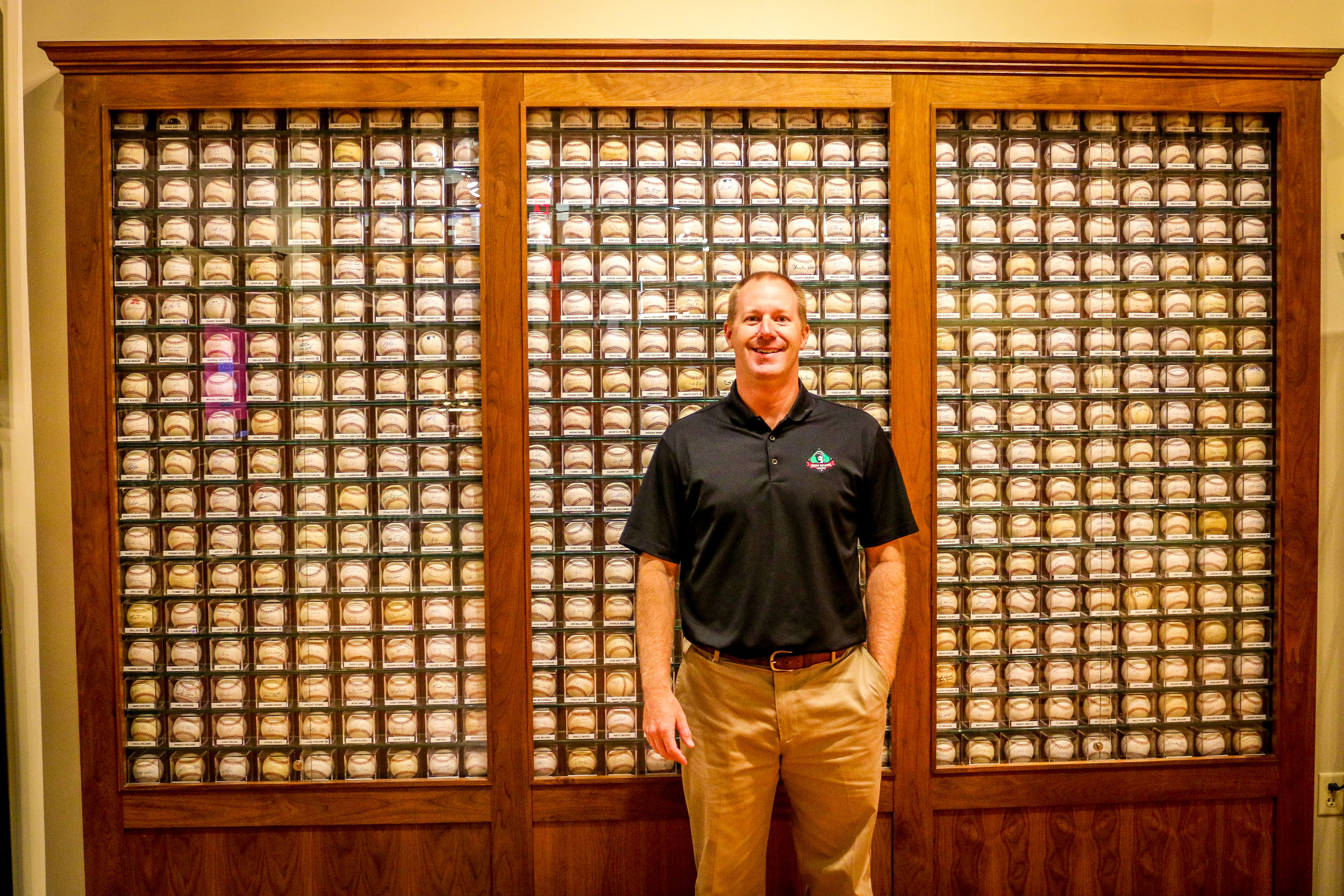 General Manager Dan Bell in Front of the Wall of Balls