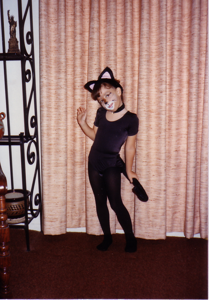 Noël Ill dressed up as a kitten for Halloween when she was little.
