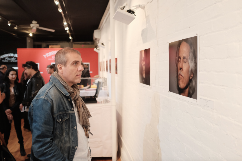 """Audio Spotlight engages a visitor at the Morrison Hotel Gallery's """"Face the Music"""" exhibit in New York City"""