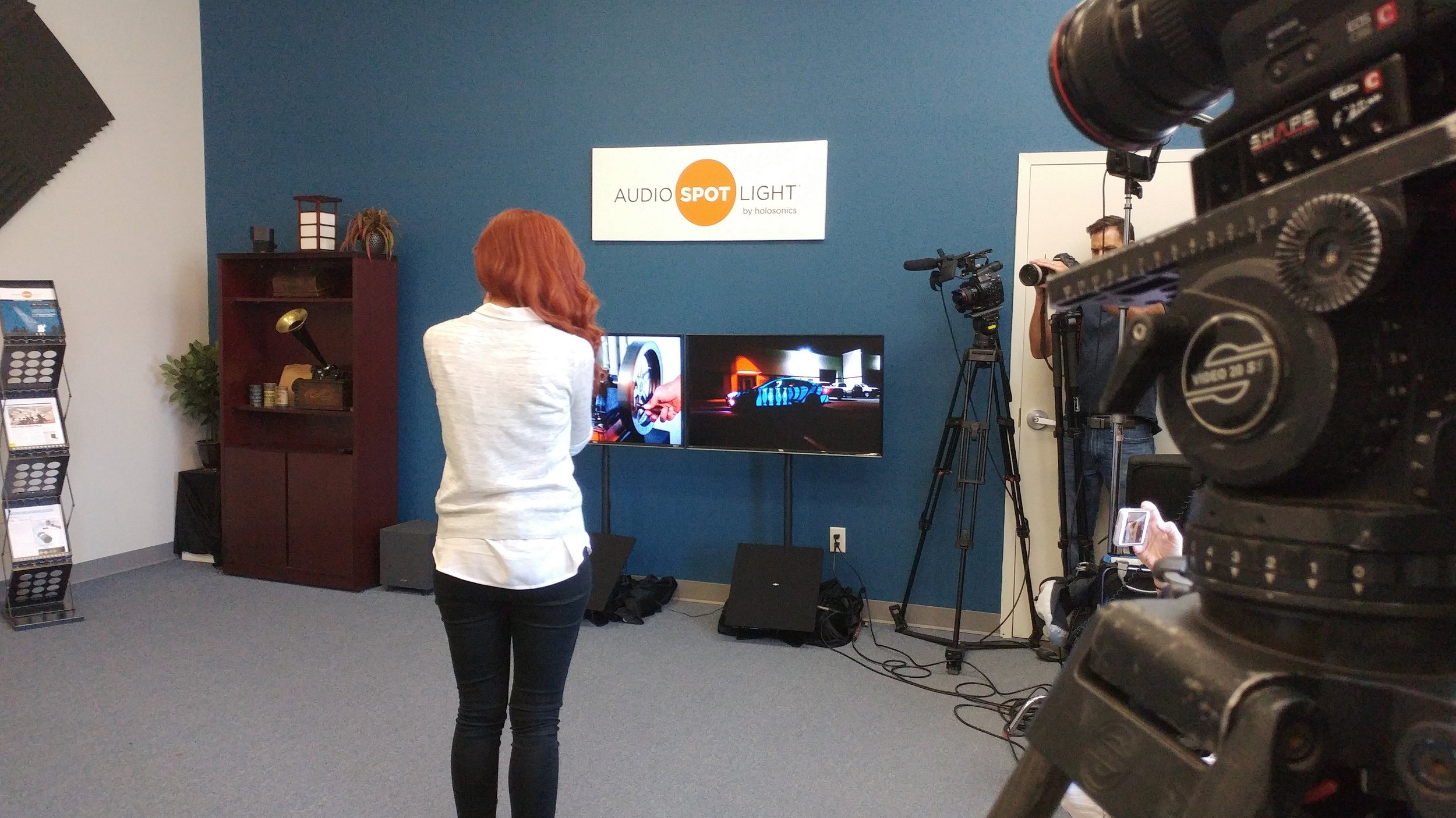 CBS correspondent Alie Ward gets a firsthand demonstration of Audio Spotlight technology