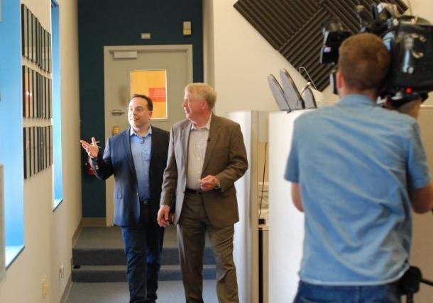 Holosonics founder Dr. F. Joseph Pompei (left) discusses Audio Spotlight technology with host Mike Wankum during the video shoot