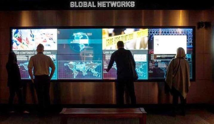 With sound from four ceiling-mounted Audio Spotlight speakers, patrons view the Global Networks exhibit