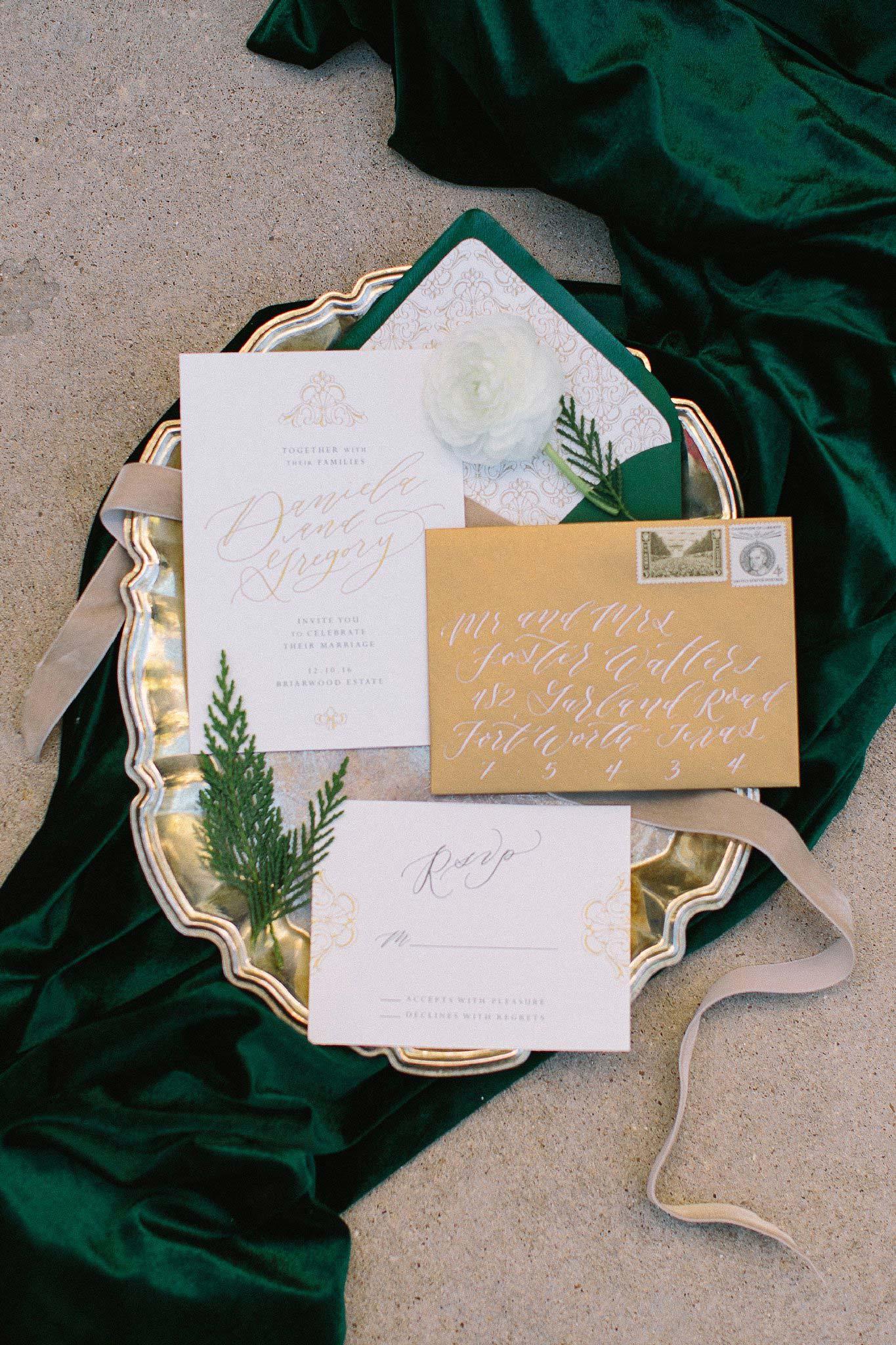 aristide mansfield wedding green and gold invitations on velvet green fabric
