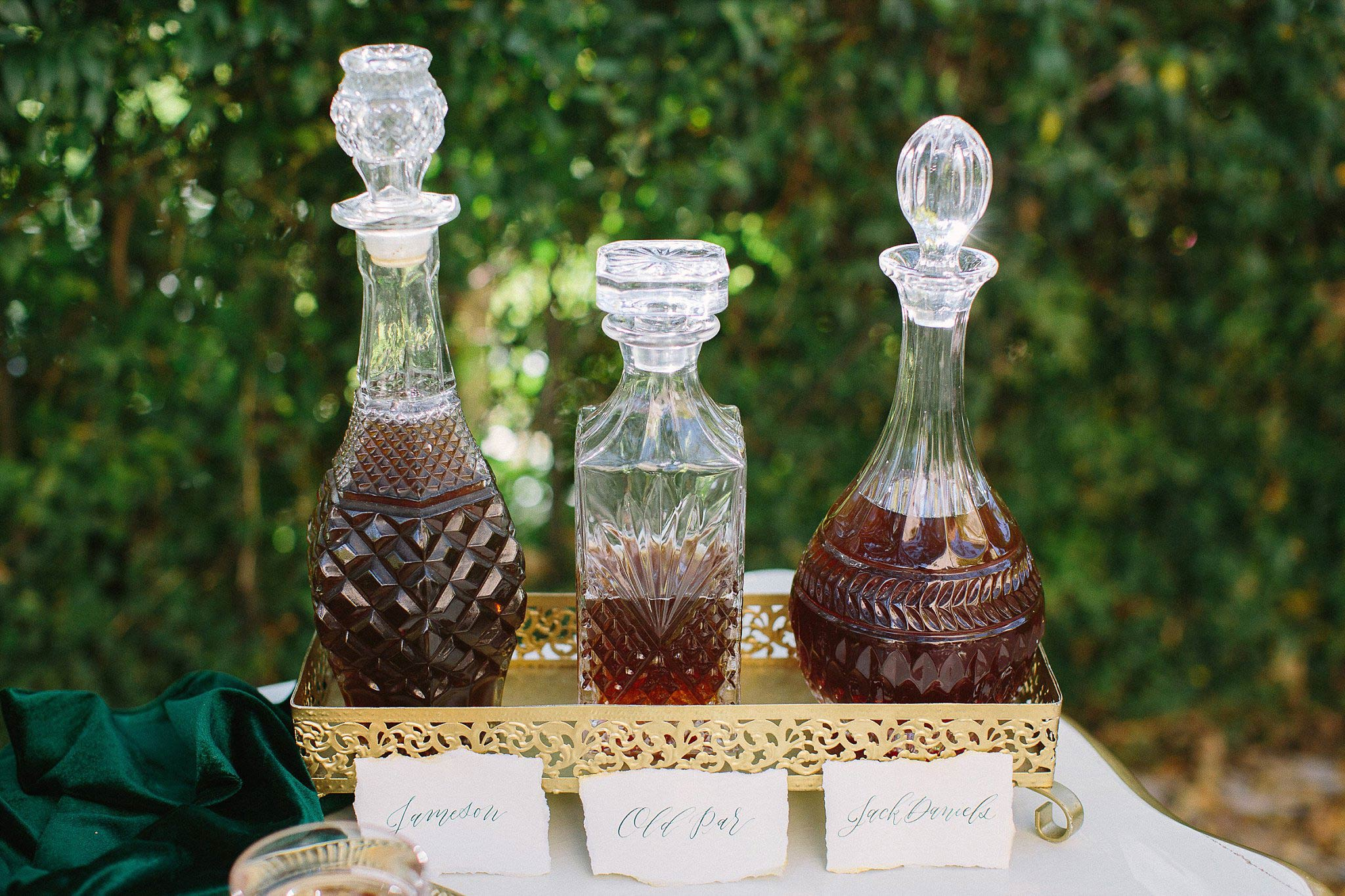 aristide mansfield wedding whiskey bar with antique decanters