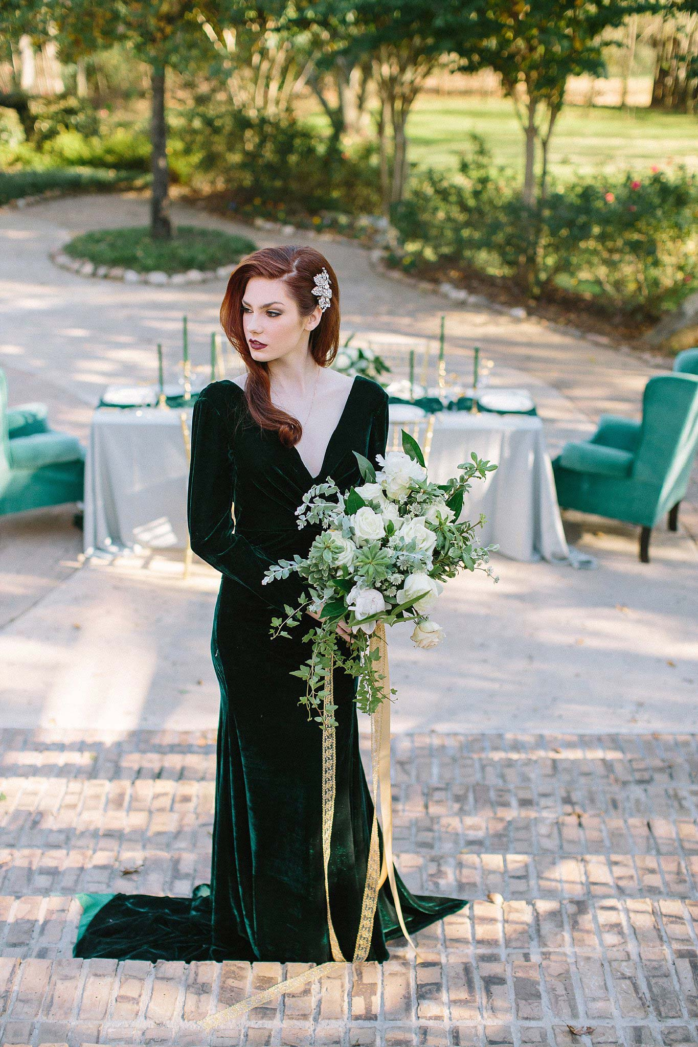 aristide mansfield wedding bridesmaid holding bouquet on stairs with table in background