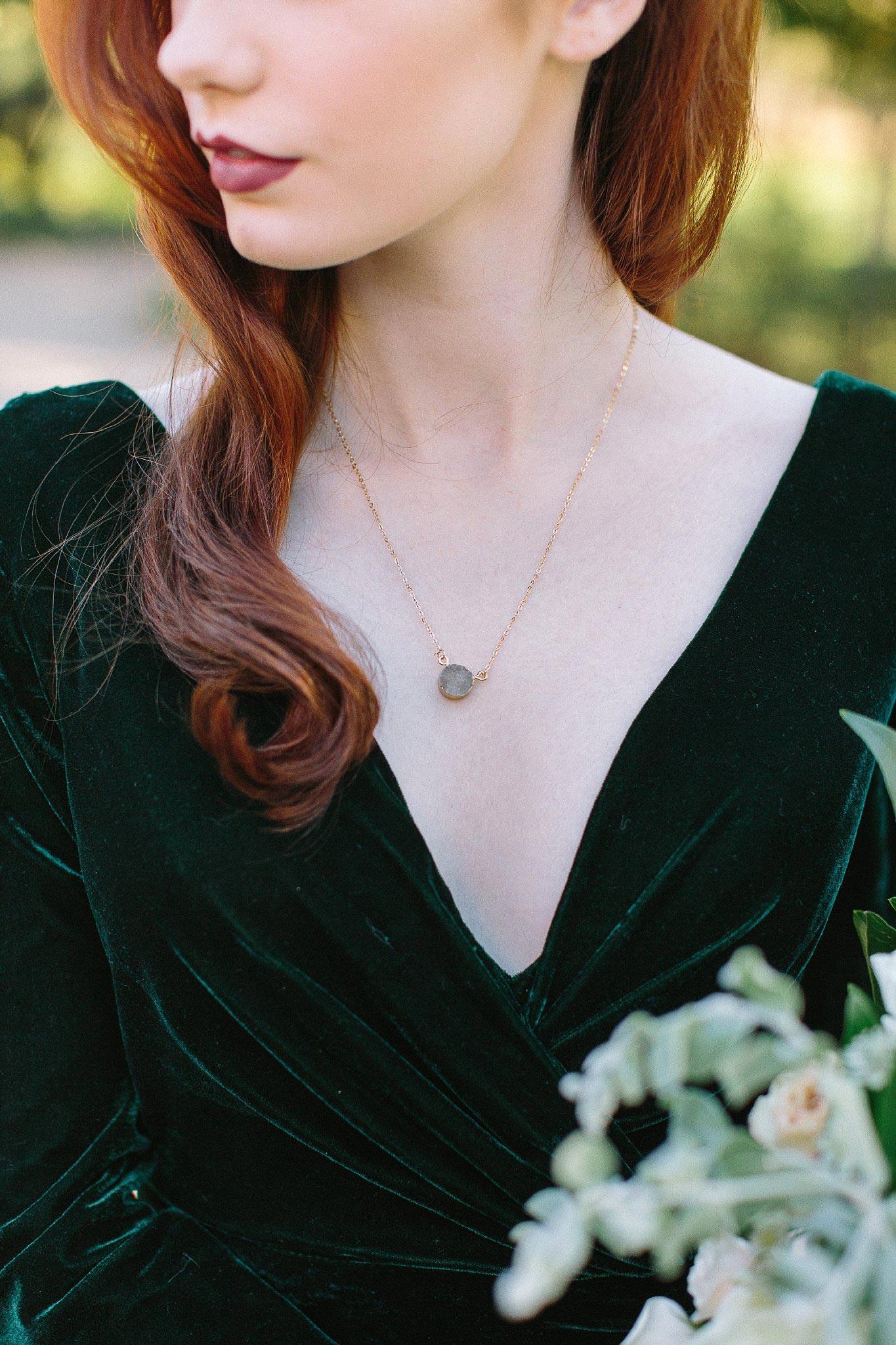 aristide mansfield wedding greenery dress with jewel necklace