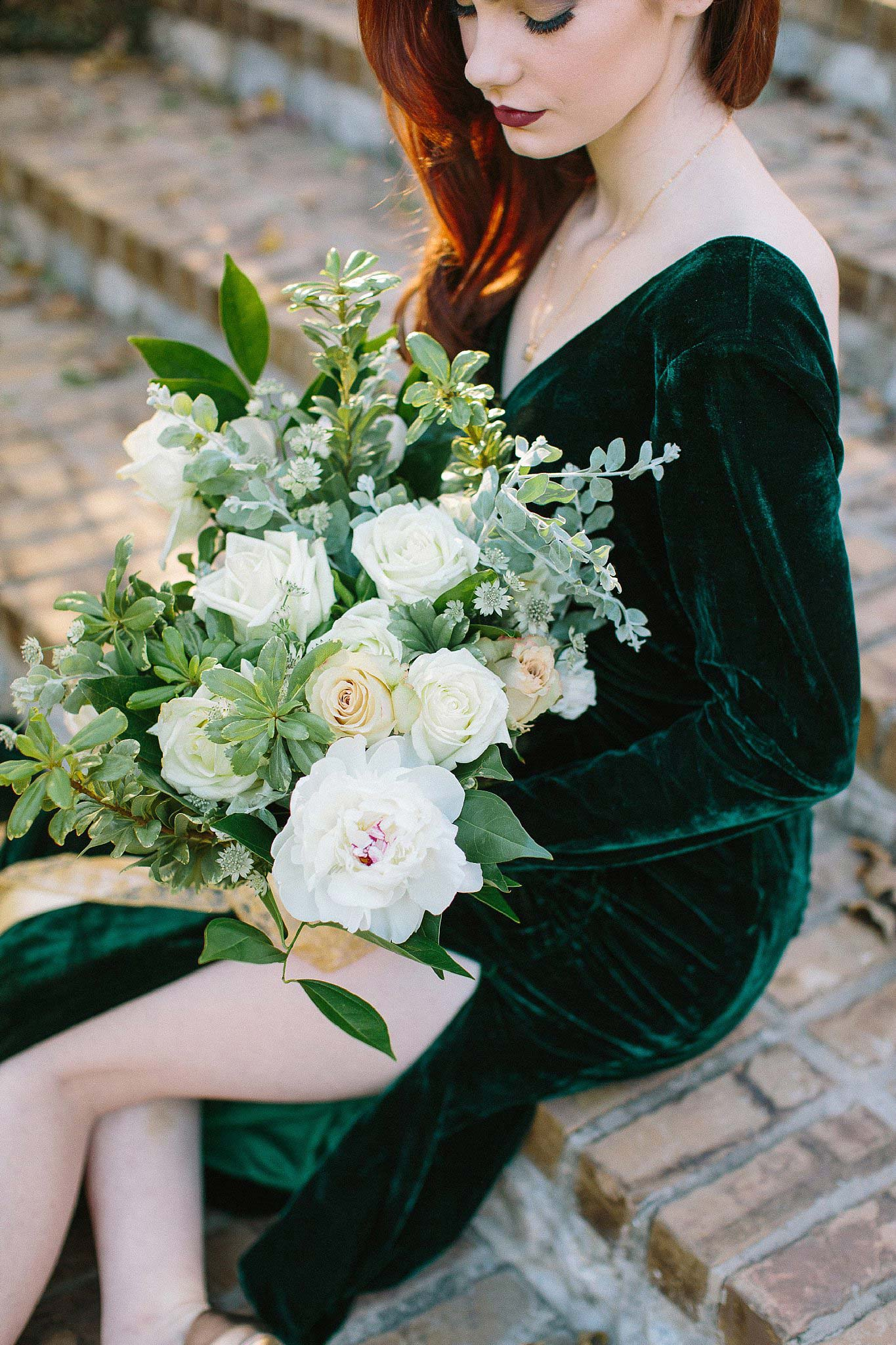 aristide mansfield wedding greenery and white flower bouquet with gold ribbon