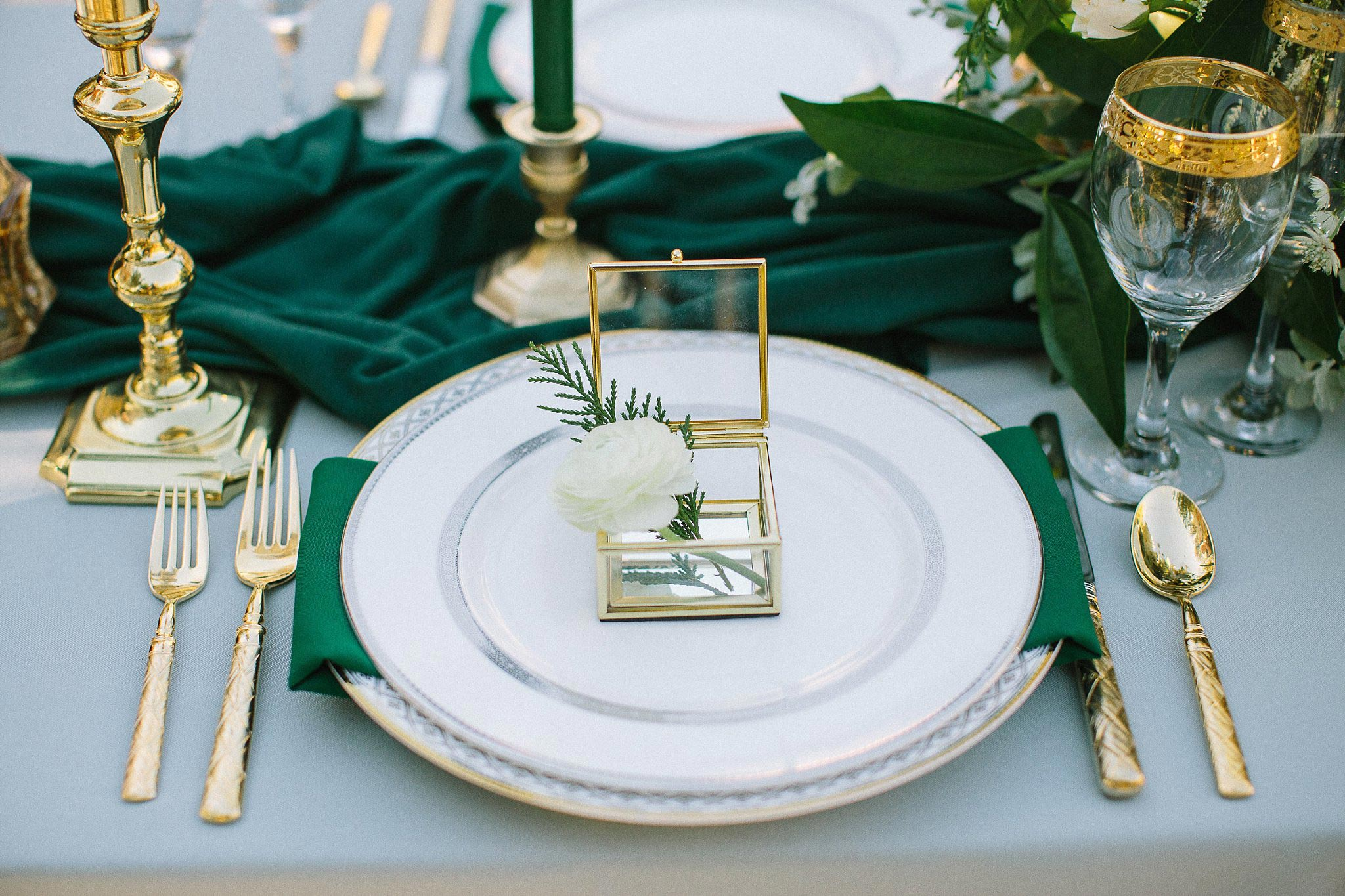 aristide mansfield wedding grey reception table with ring box at bride's seat with a white flower