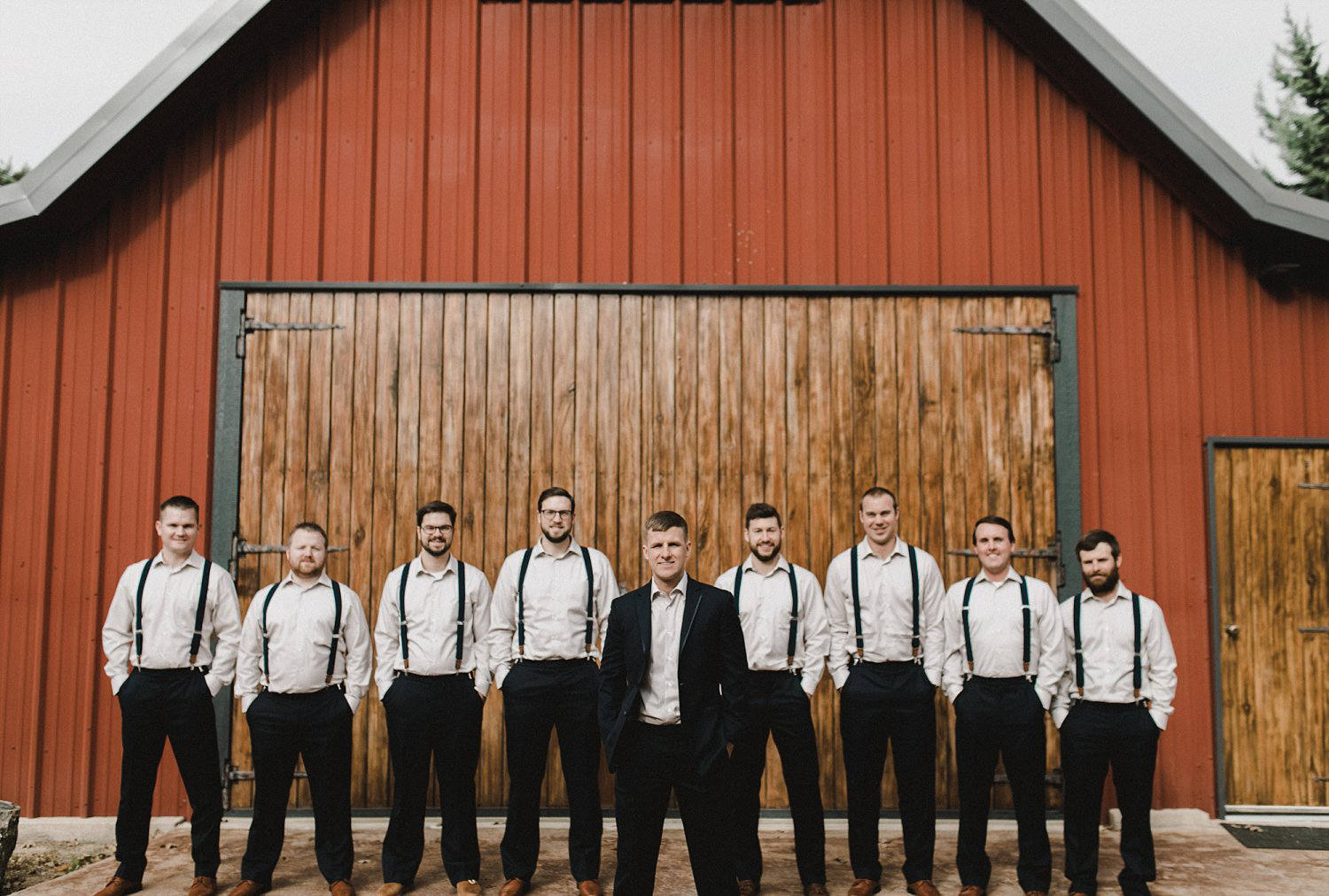 Hollow Hill Farm Event Center Wedding groomsmen with suspenders suites