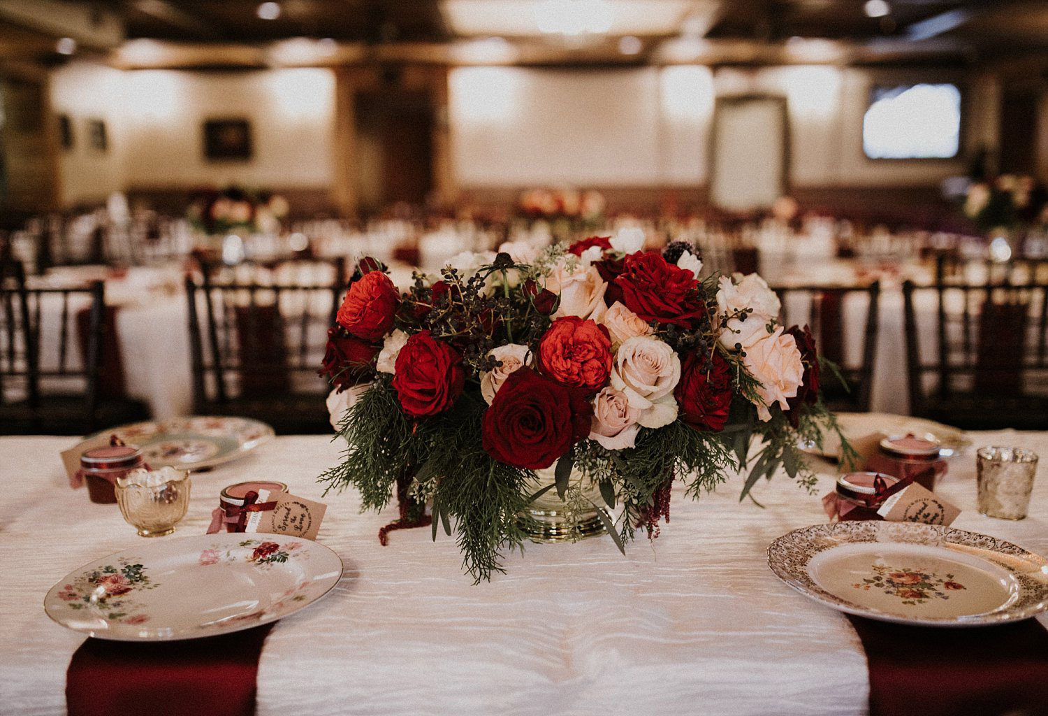 Hollow Hill Farm Event Center Wedding red and cream floral centerpiece with evergreens and berries
