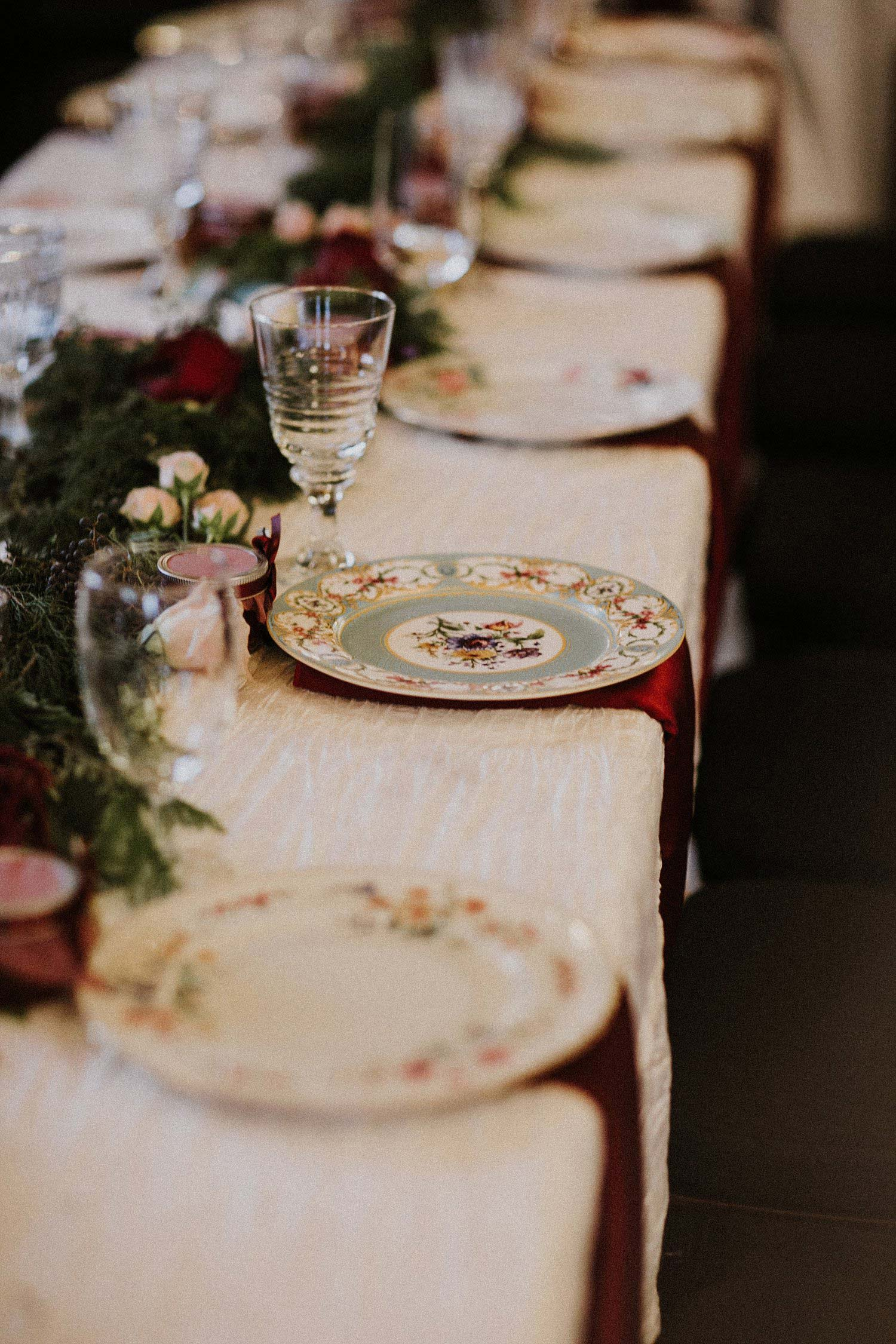 Hollow Hill Farm Event Center Wedding table with vintage china and red napkins