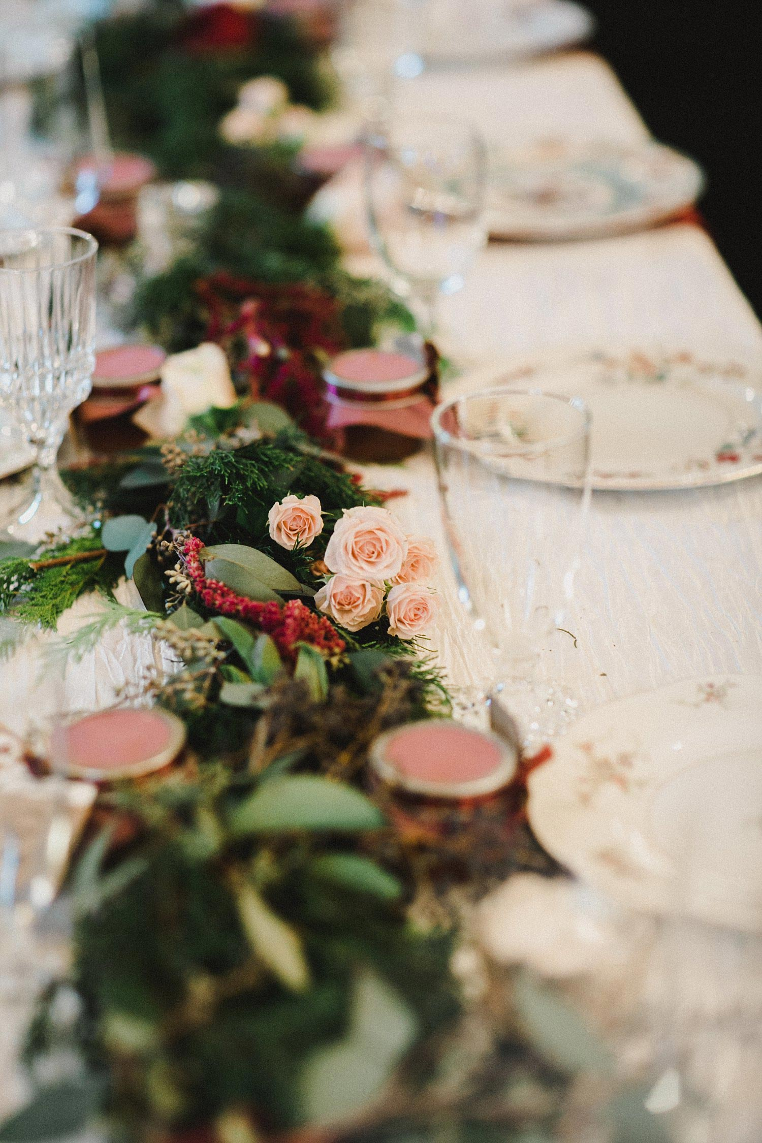 Hollow Hill Farm Event Center Wedding table garland with evergreen greenery and blush and cream rose