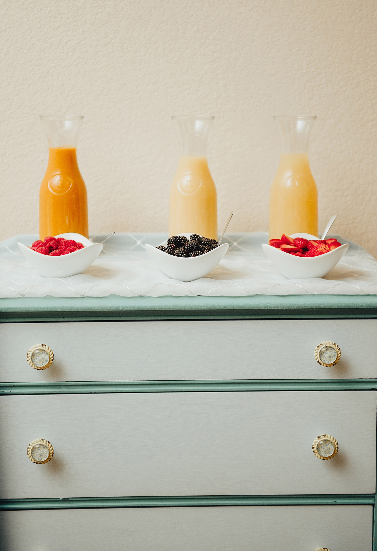 The Orchard Azle wedding mimosa bar on dresser