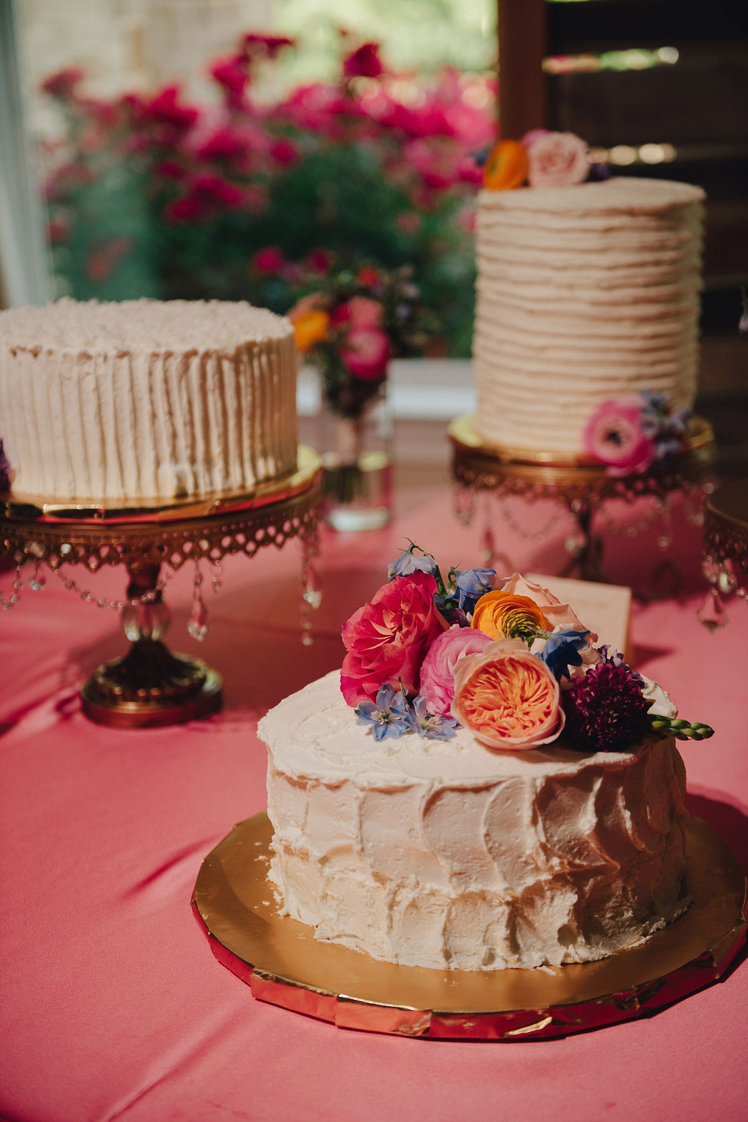 wedding cake on pink linen