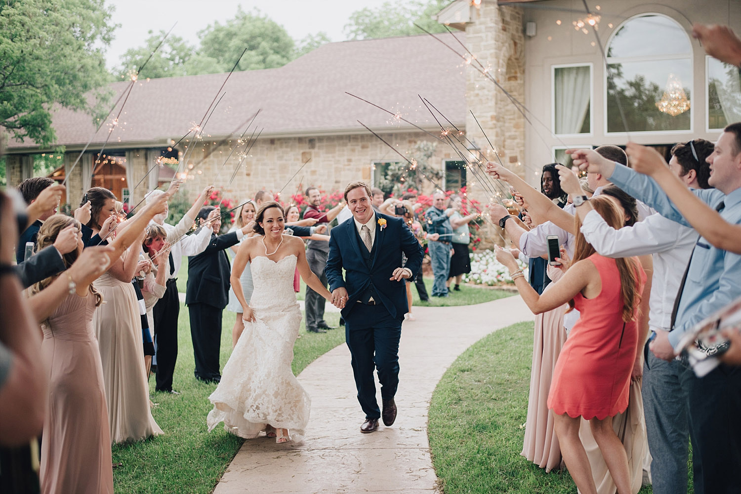 The Orchard Azle wedding sparkler exit during the day