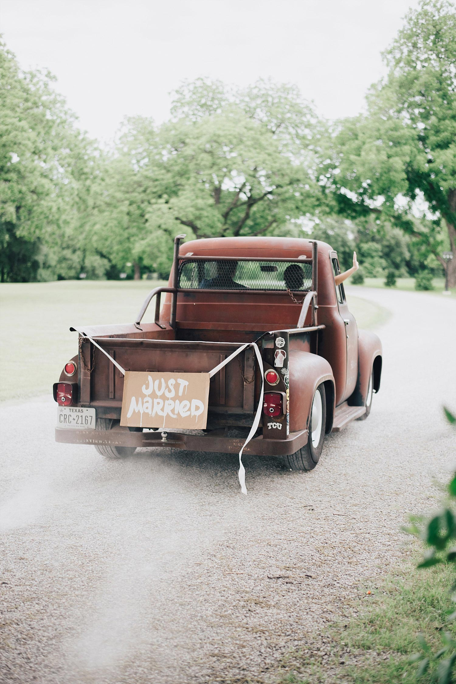 The Orchard Azle wedding vintage truck exit
