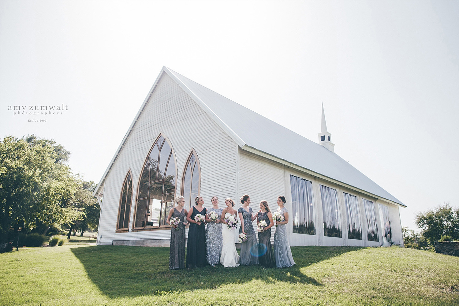 The Brooks at Weatherford white chapel with bridesmaids in sequin silver dresses