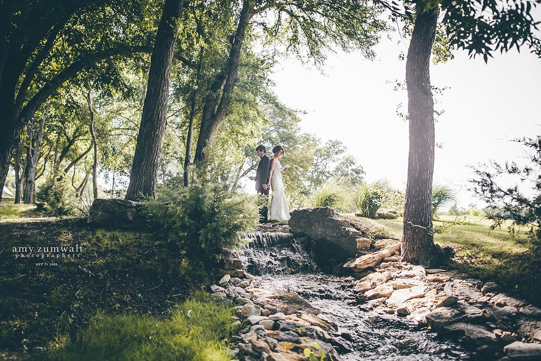 Brooks at Weatherford bride and groom praying on creek bridge