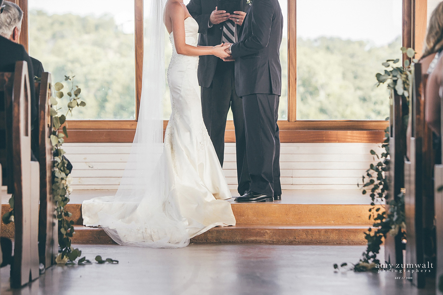 The Brooks at Weatherford wedding ceremony by chapel's windows