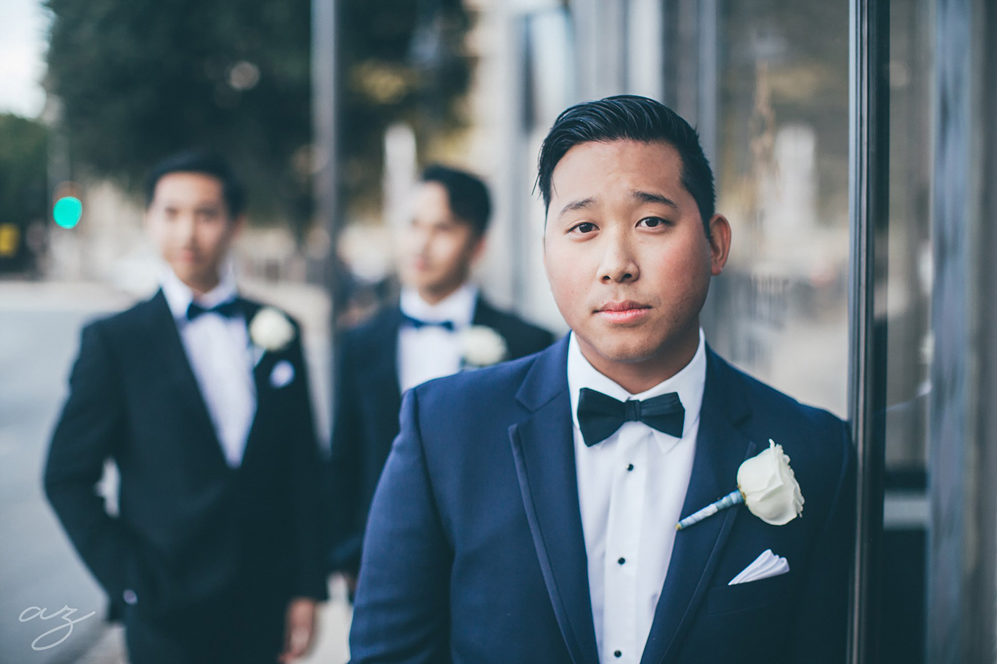 Carlisle Room wedding Groom in grey tux with white boutonniere