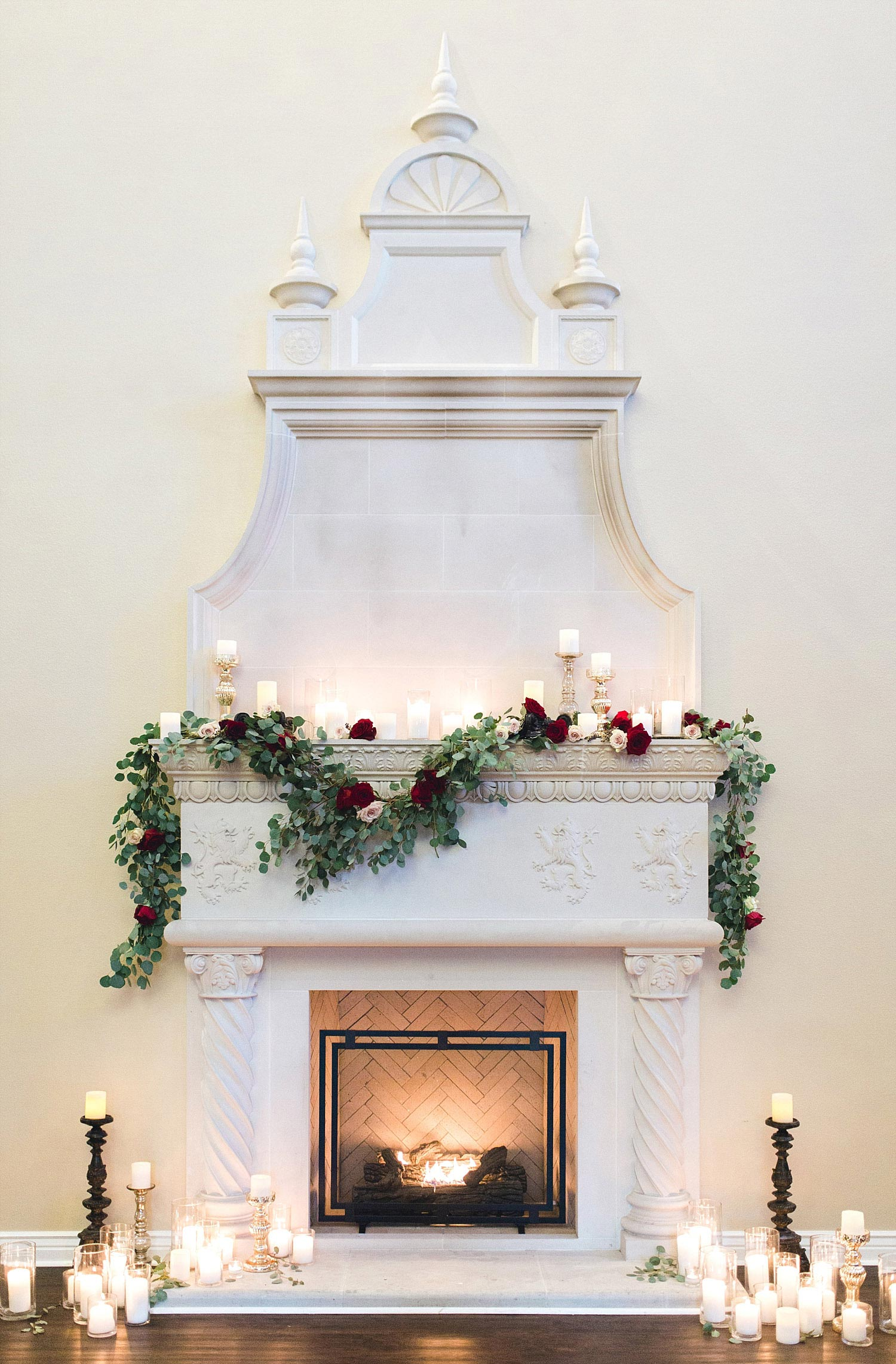 Castle at Rockwall wedding white fireplace with garland and candles photo