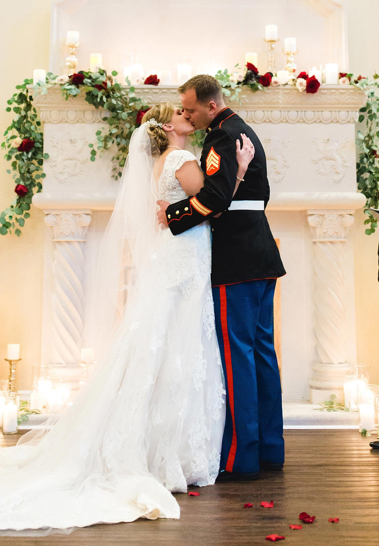 Castle at Rockwall wedding bride and marine groom kiss infront of white fireplace
