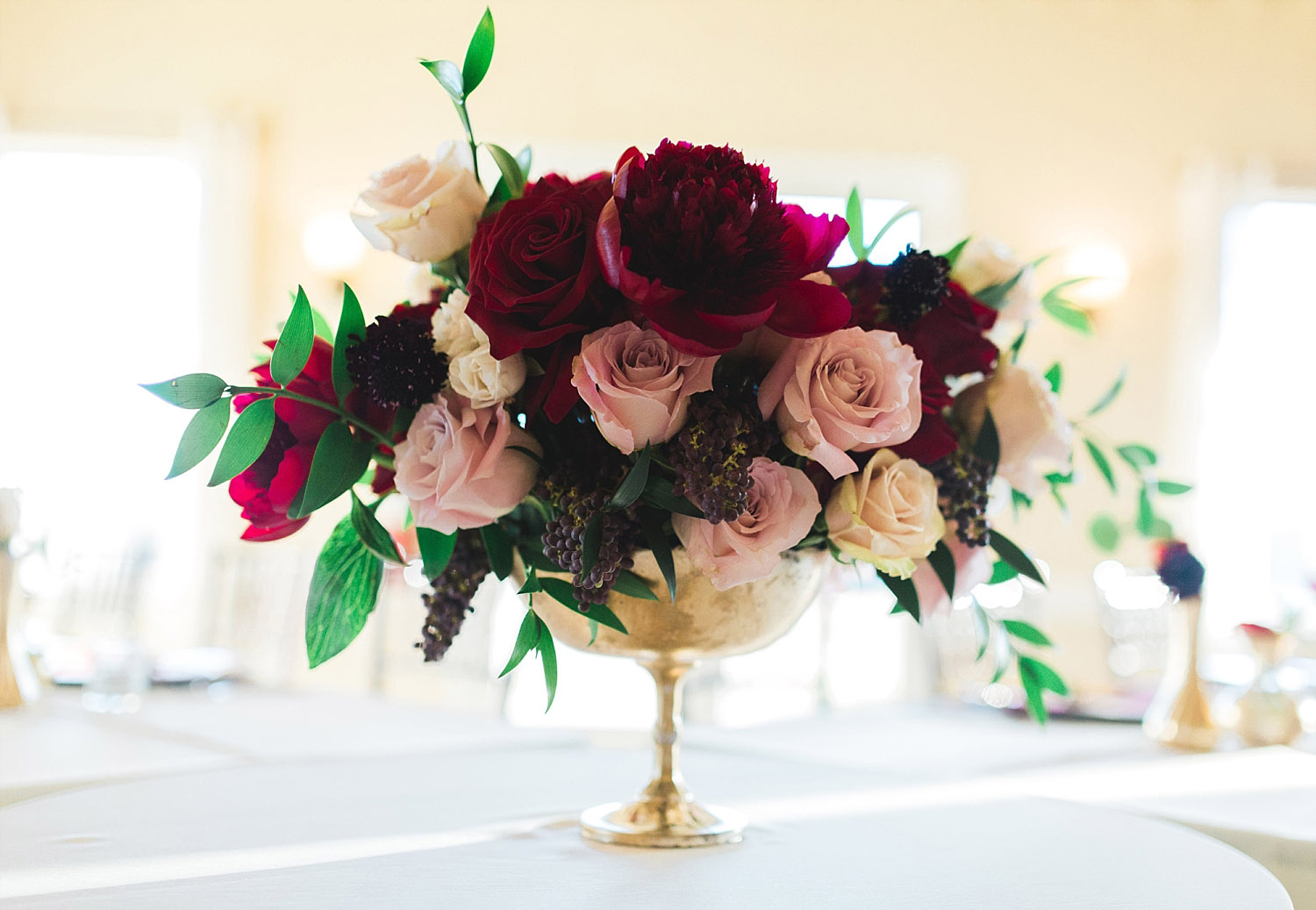 Castle at Rockwall wedding marsala blush and cream flowers in gold vase