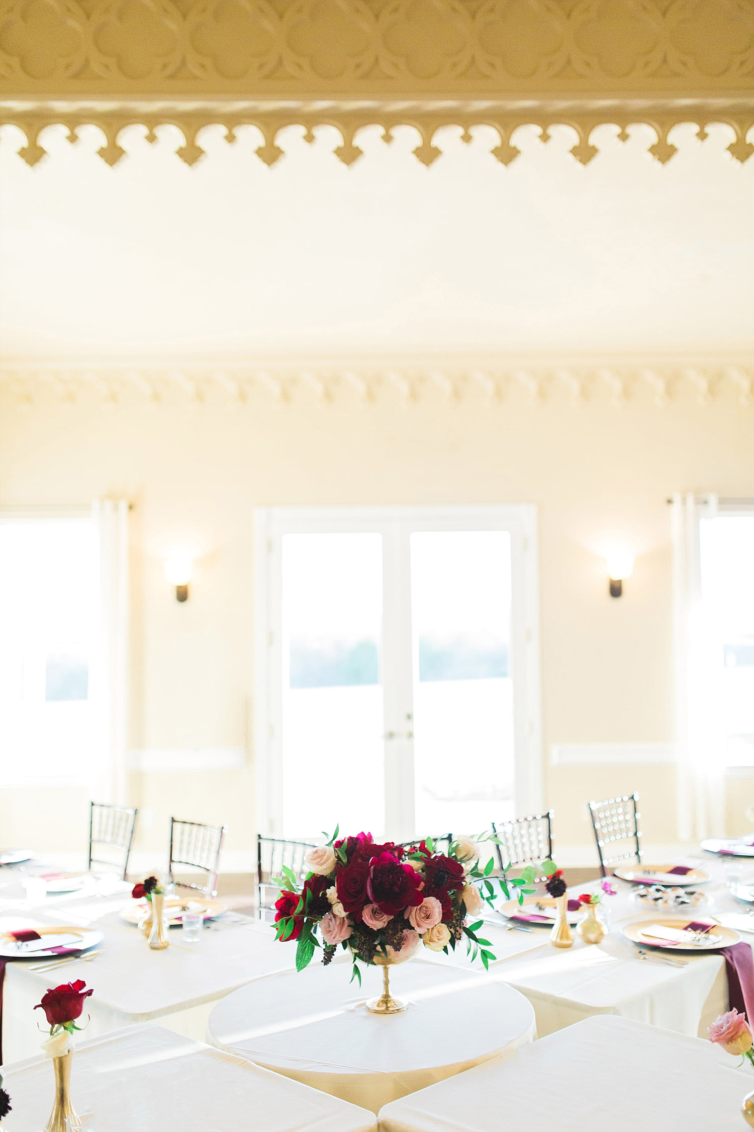 Castle at Rockwall wedding banquet room with red flowers
