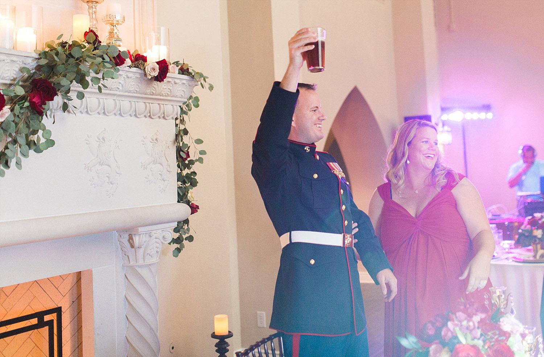Castle at Rockwall wedding marine groom toasting